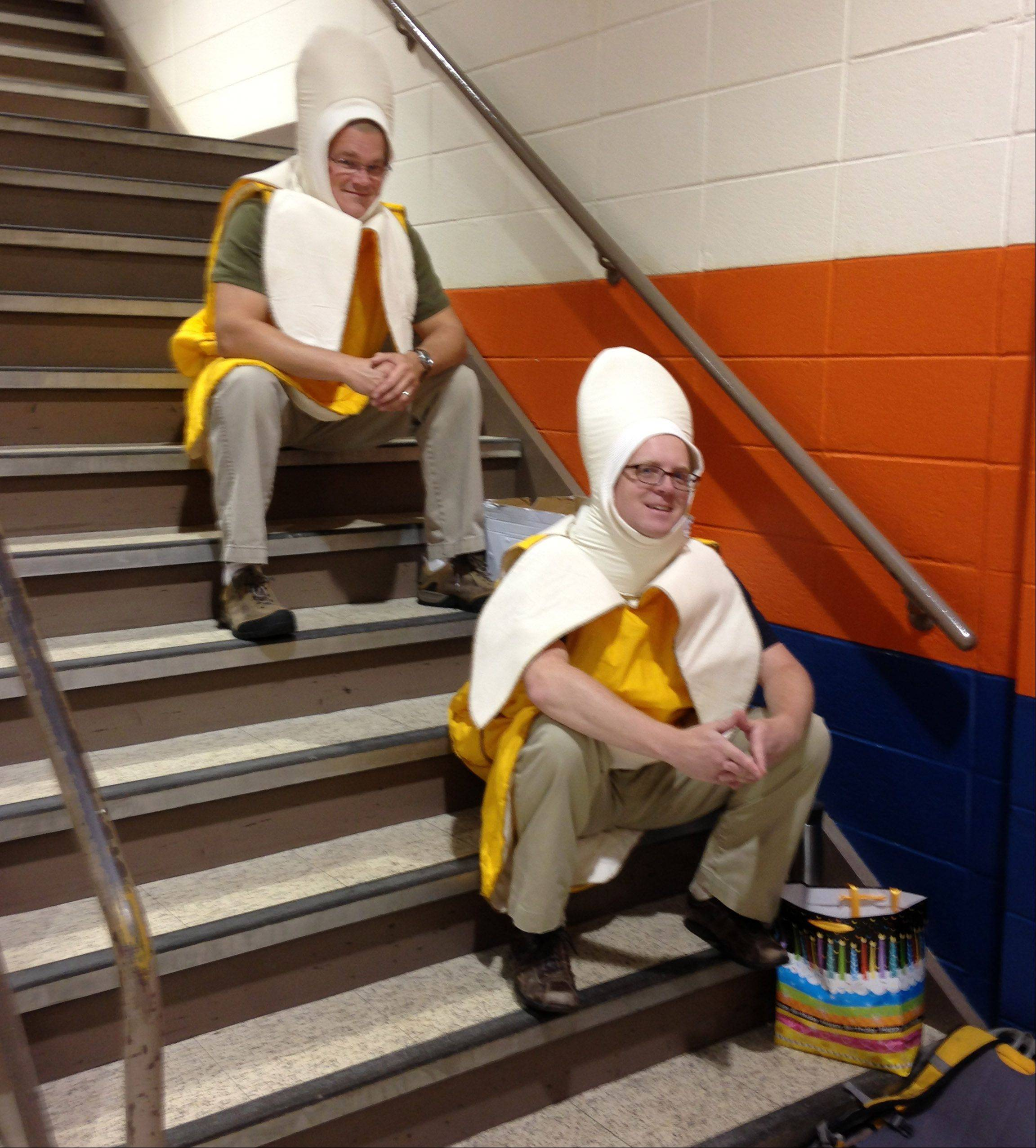 "Buffalo Grove High School Physics teachers Tim Kosiek, top, and Rich Schram wait to go on stage to preform the ""banana cheer"" with the complete student body during the first day of school rally. ""Its a way to make the first day of school rally fun and unite the student body"", said Kosiek. This picture was published in the weekly Perspective column."