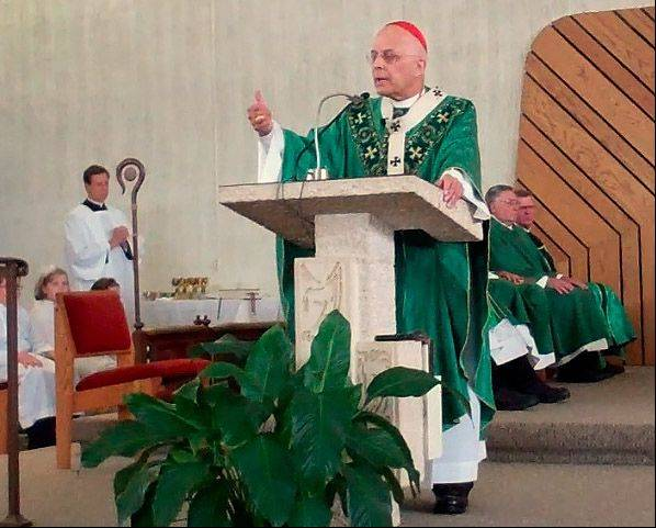 "Cardinal Francis George delivers his homily Sunday during the ""Blue Mass"" at Queen of the Rosary Church in Elk Grove Village. His talk, though, focused on the crisis in Syria."