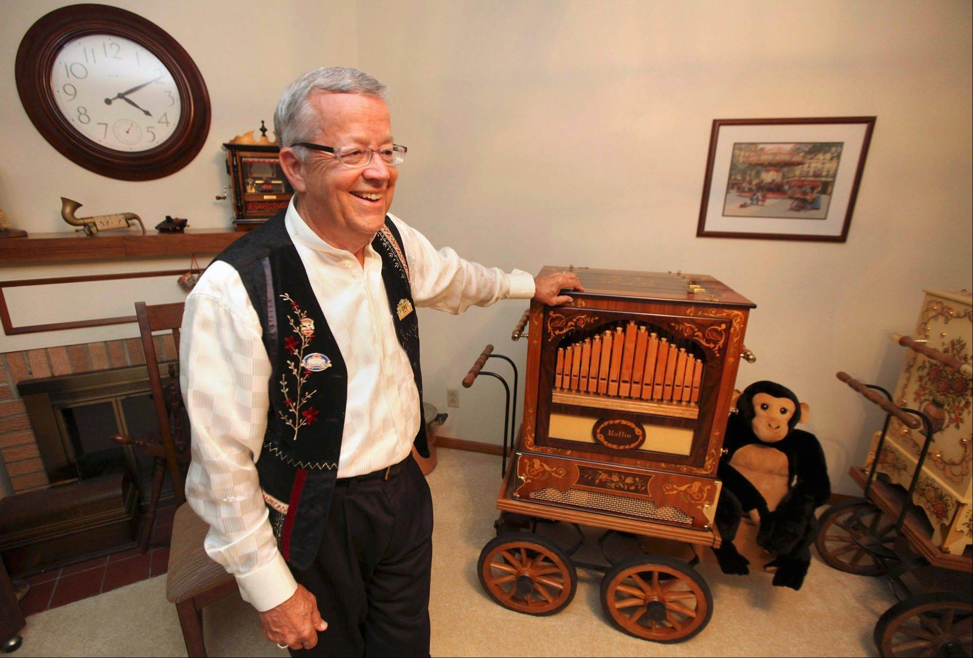 David Mahr smiles as he talks about his Raffin street organ at his home in Decatur, Ill. Mahr, a member of the Carousel Organ Association of America and collector of hand-cranked street organs, nickelodeons, player pianos and all forms of mechanical music, has brought this organ with him to about 35 different festivals across the United States.