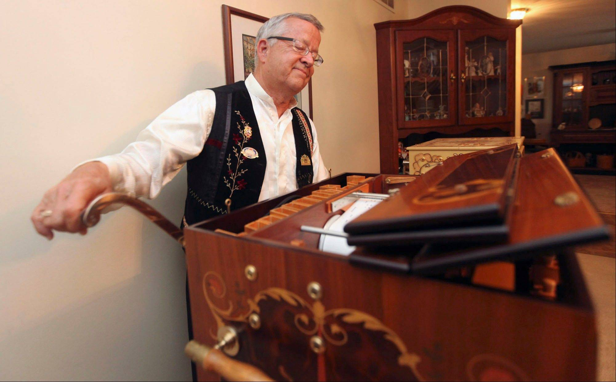 David Mahr closes his eyes and listens to the music from his Raffin street organ as he turns the crank at his home in Decatur, Ill. The organ was made in 2001 and has 124 pipes. Mahr, a member of the Carousel Organ Association of America and collector of hand-cranked street organs, nickelodeons, player pianos and all forms of mechanical music, has brought this organ with him to about 35 different festivals across the United States.