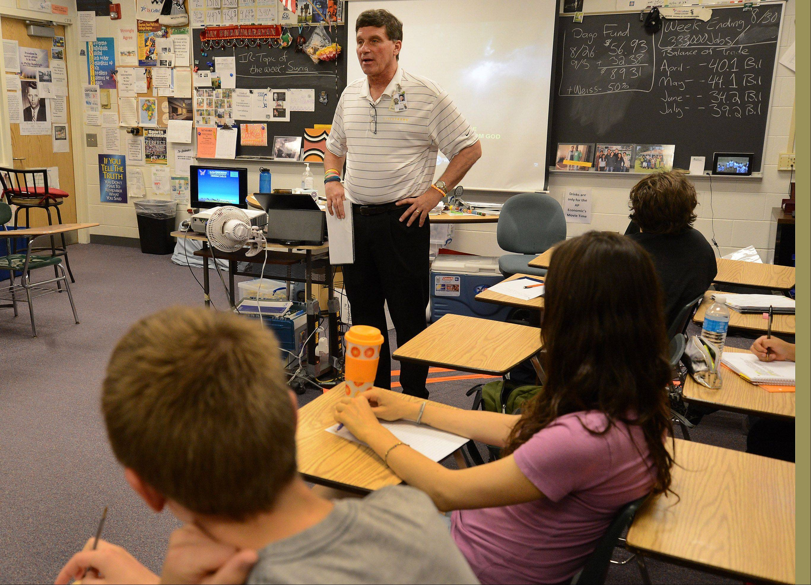 In a classroom filled with meaningful quotations from around the globe, Bartlett High School teacher Brett Weiss can bring firsthand knowledge to his international relations class. Weiss started a charity that funds high school educations for children in a rural African village stricken with AIDS and poverty.