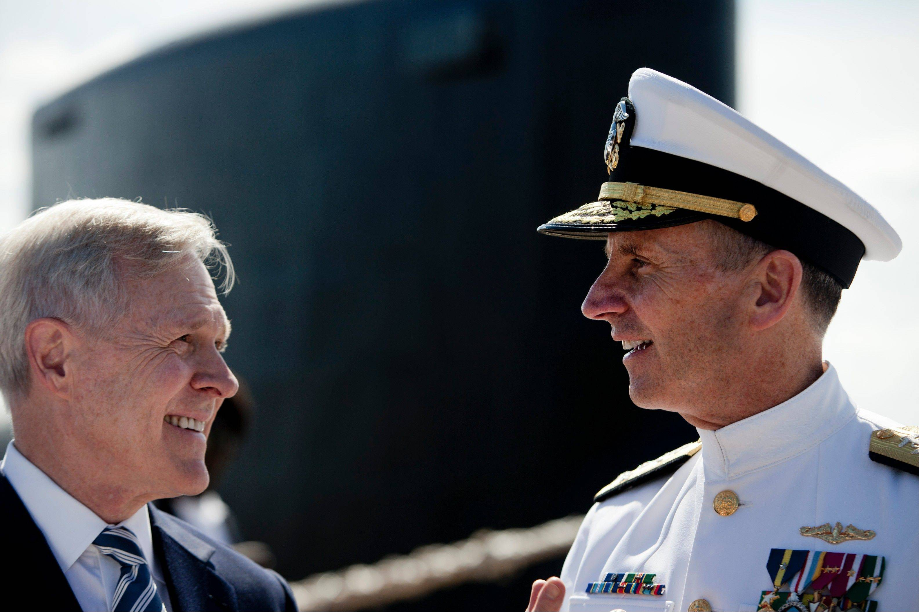 Secretary of the Navy, Ray Mabus, left, and Admiral Jonathan Greenert, Chief of Naval Operations, chat Saturday after commissioning ceremonies for the Virginia class submarine USS Minnesota.
