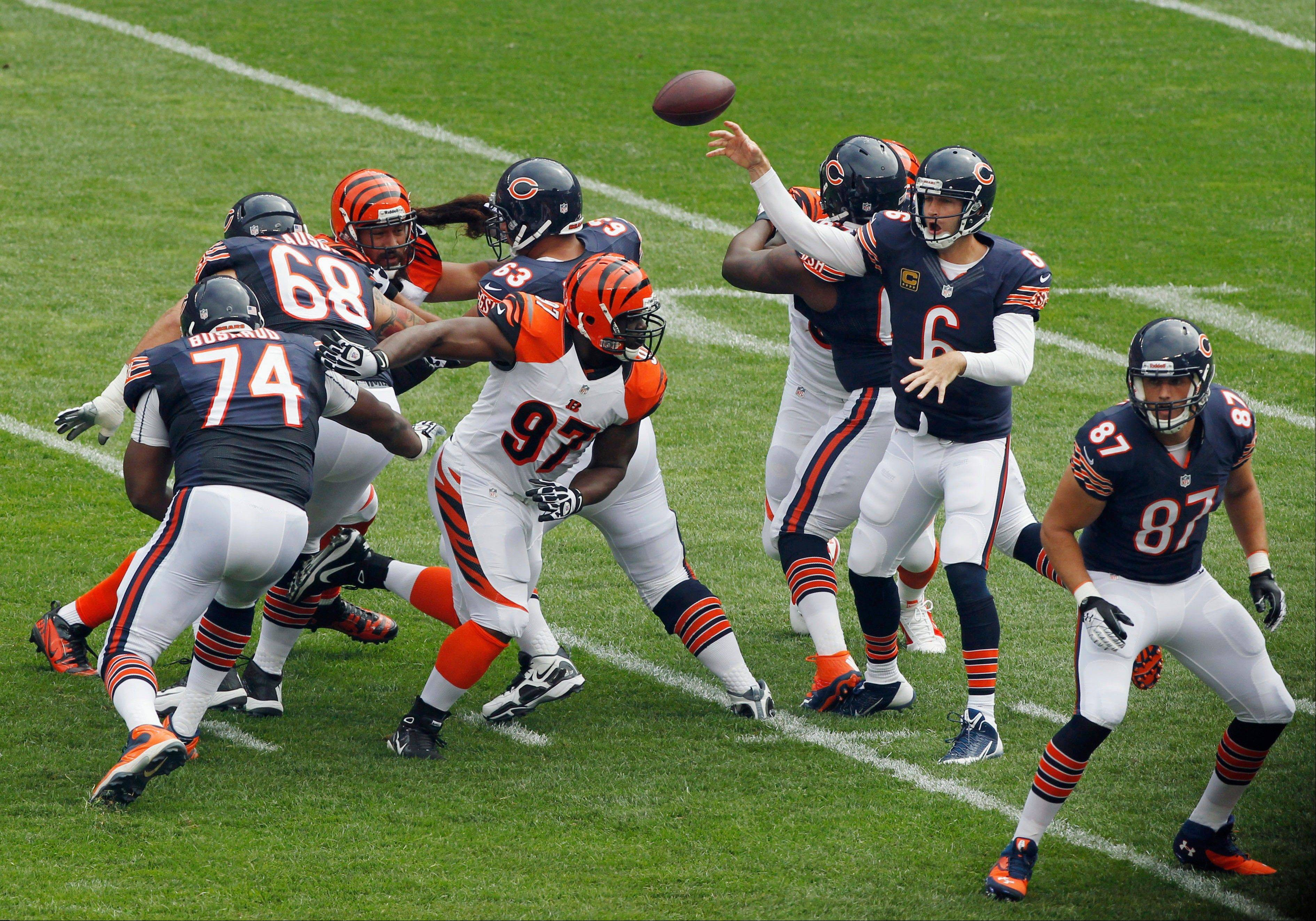 Chicago Bears quarterback Jay Cutler (6) throws a pass under pressure from Cincinnati Bengals defensive tackle Geno Atkins (97) during the first half of an NFL football game, Sunday, Sept. 8, 2013, in Chicago.