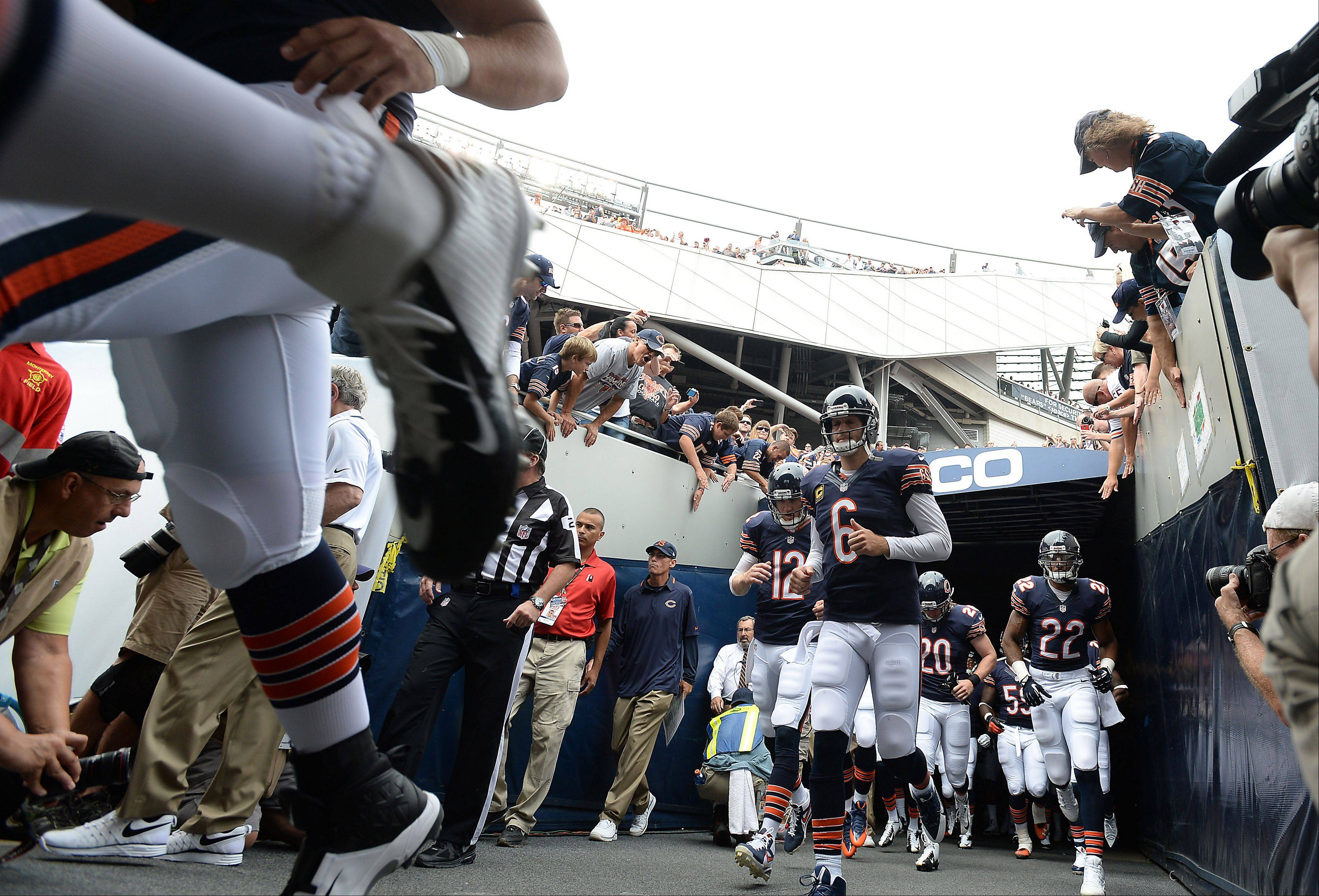 Chicago Bears quarterback Jay Cutler runs out onto the field in the season opener against the Cincinnati Bengals at Soldier Field in Chicago on Sunday.
