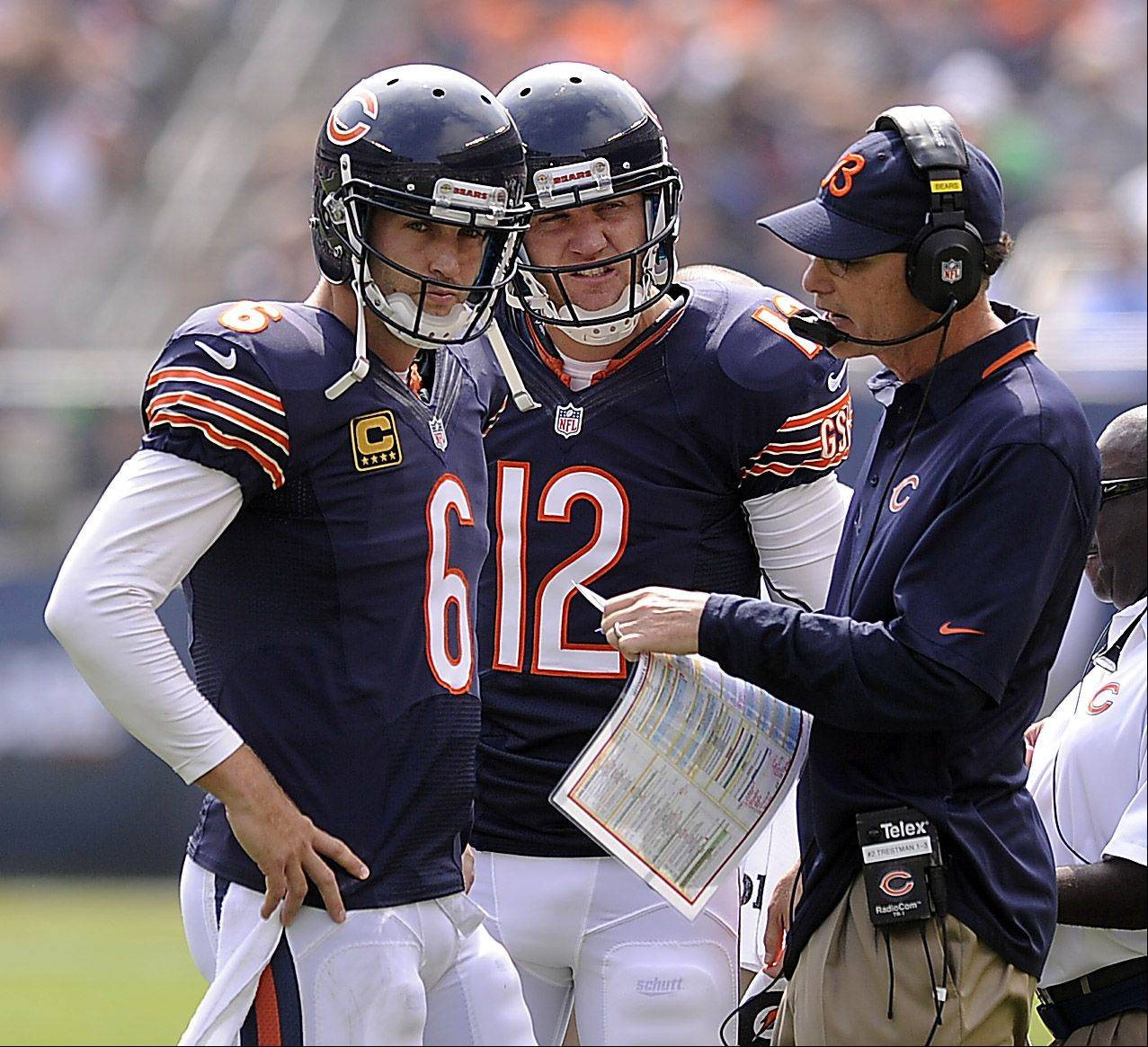 Chicago Bears head coach Marc Trestman talks things over with quarterback Jay Cutler and backup quarterback Josh McCown in the season opener at Soldier Field in Chicago.