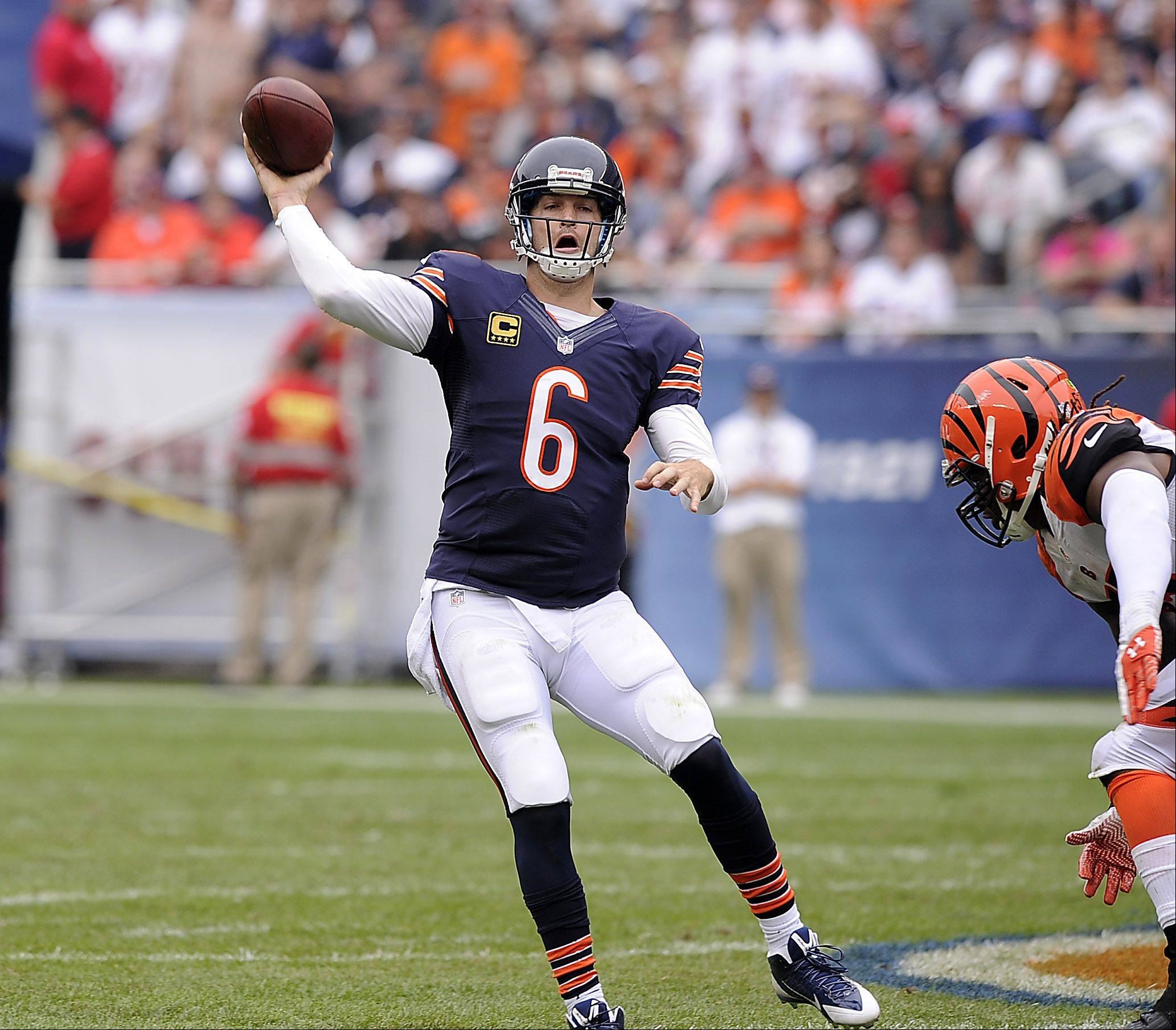Chicago Bears quarterback Jay Cutler on the run looks downfield for a receiver in the second quarter in the season opener against the Cincinnati Bengals at Soldier Field in Chicago on Sunday.