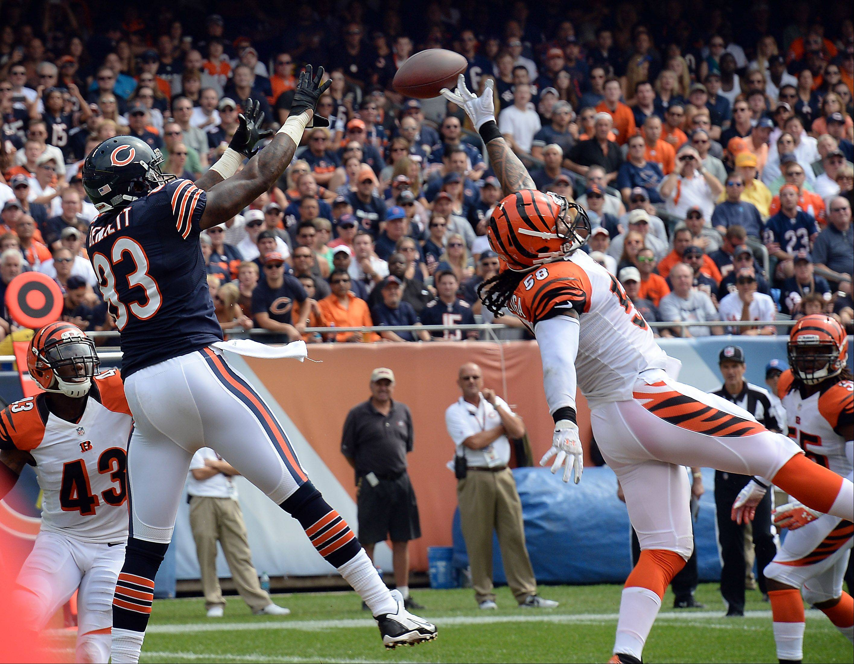 Chicago Bears Martellus Bennett makes a touchdown catch as Cincinnati Bengals Rey Maualuga tries to tip the ball in the first quarter of the season opener at Soldier Field in Chicago.