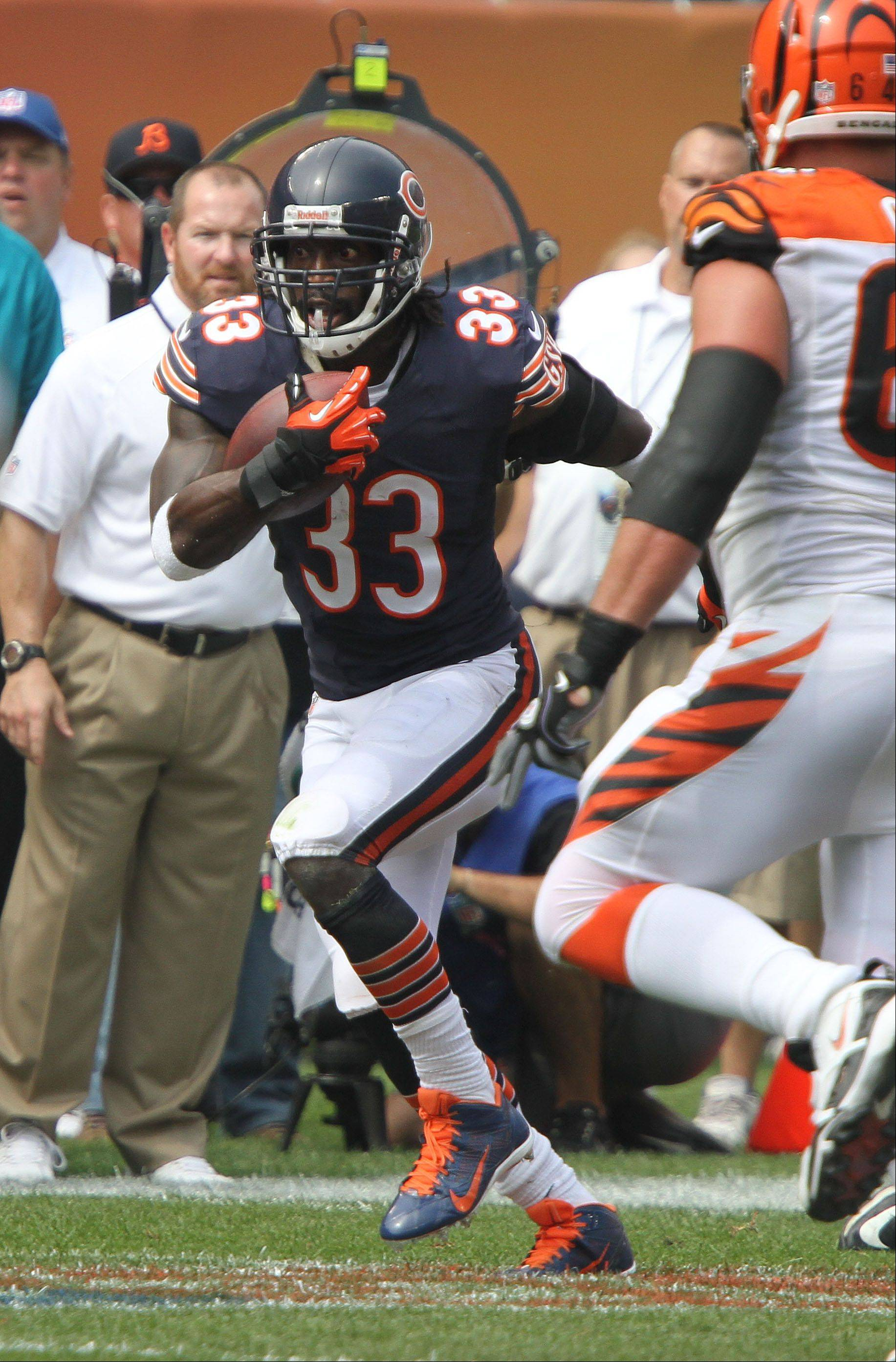 Chicago Bears cornerback Charles Tillman runs after an interception during their opening day game against the Cincinnati Bengals Sunday at Soldier Field in Chicago.