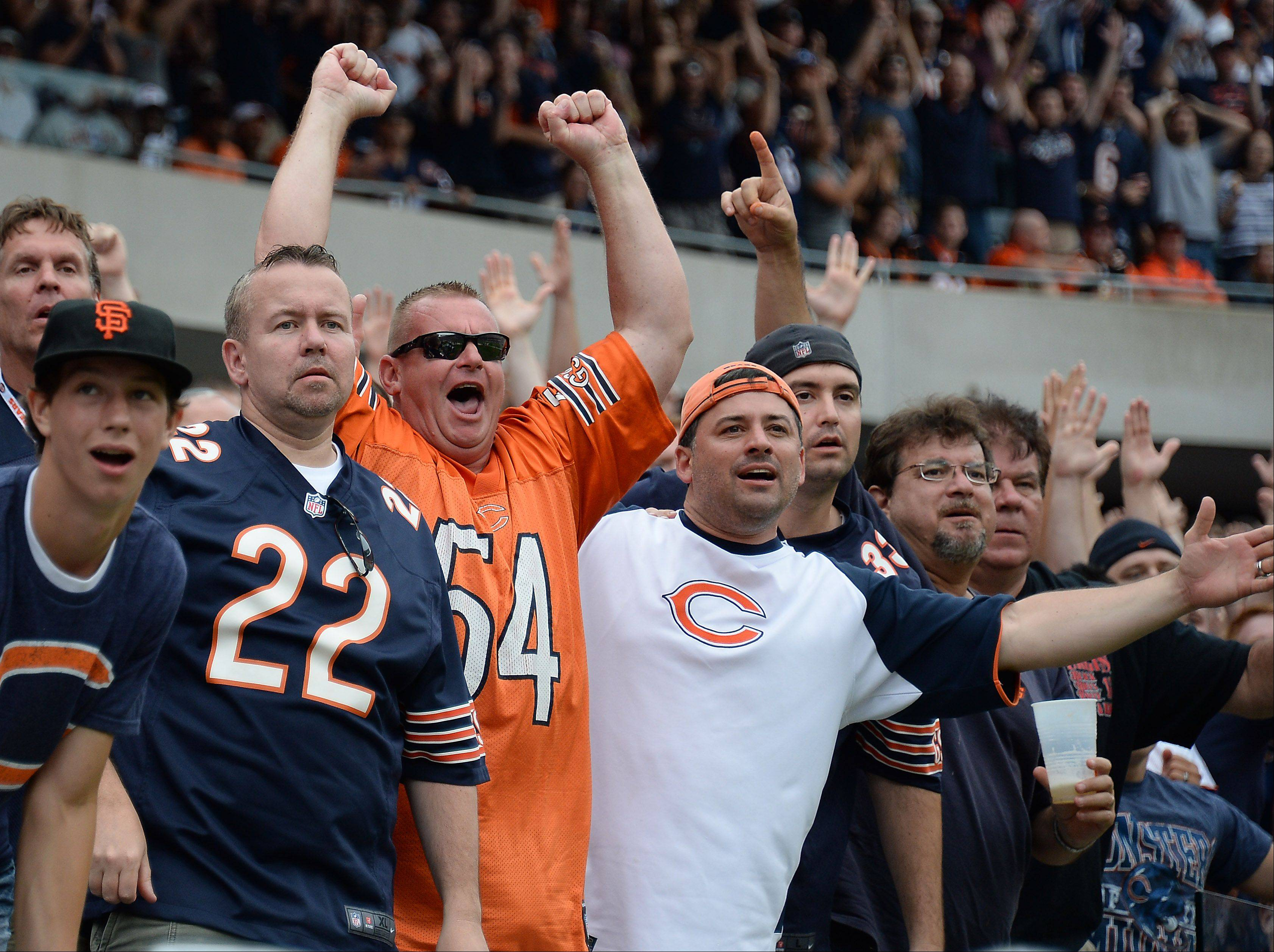 Chicago Bears fans celebrate the season opener victory against the Cincinnati Bengals at Soldier Field in Chicago on Sunday.