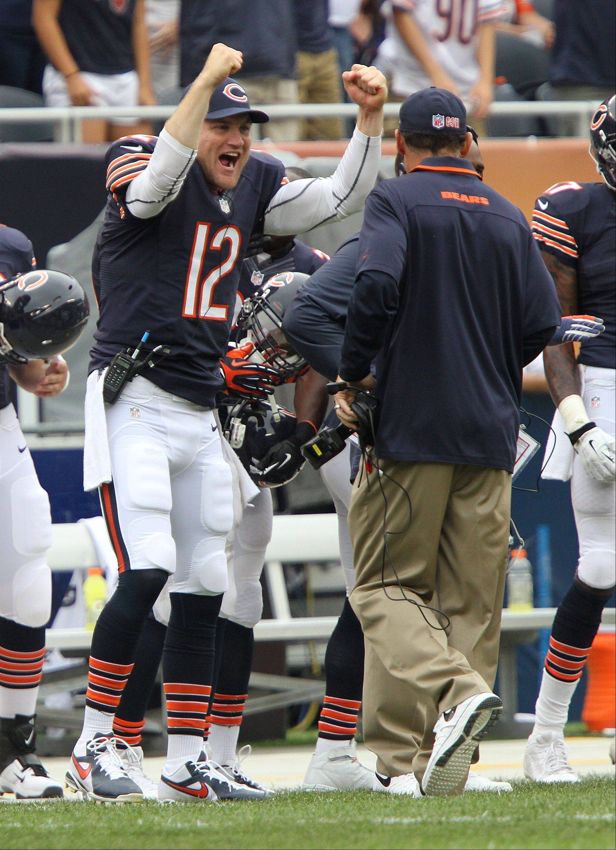 Chicago Bears quarterback Josh McCown cheers at head coach Marc Trestman after their opening day win over the Bengals Sunday at Soldier Field in Chicago.