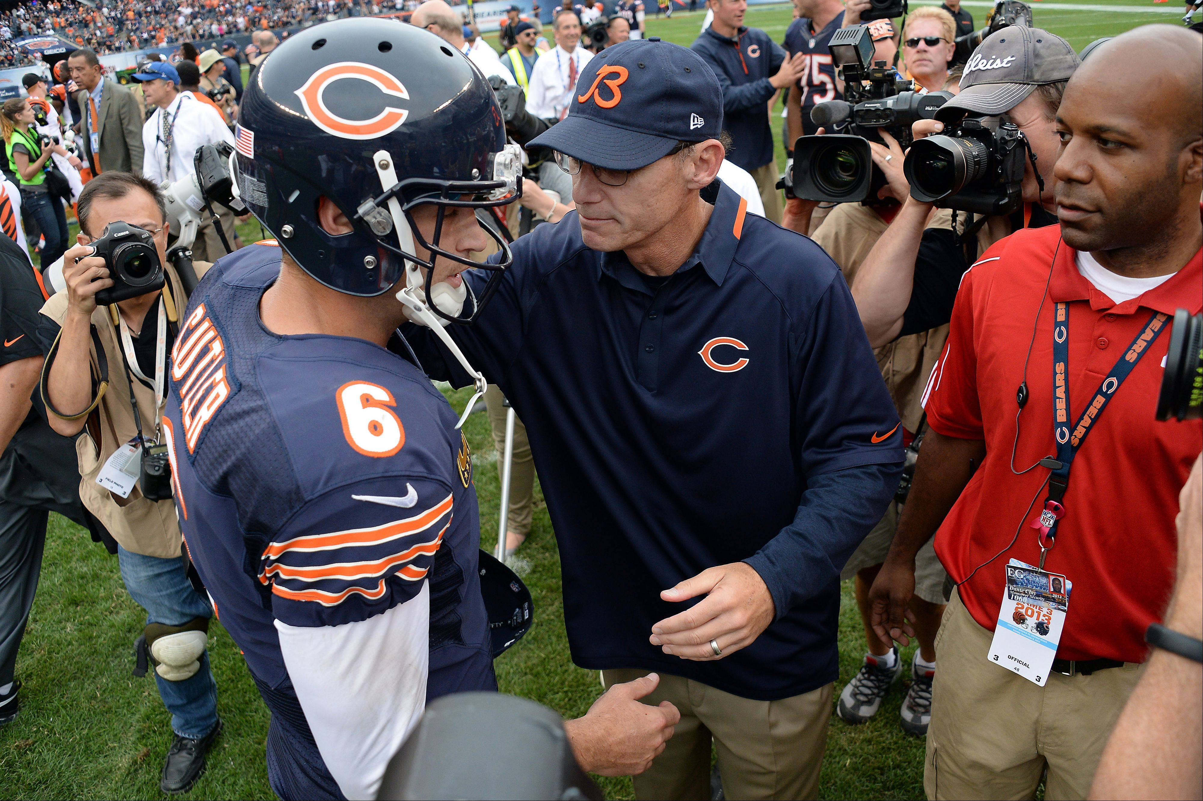 Chicago Bears coach Marc Trestman and quarterback Jay Cutler come together in a moment after the game to congratulate each other in the season opener against the Cincinnati Bengals at Soldier Field in Chicago on Sunday.