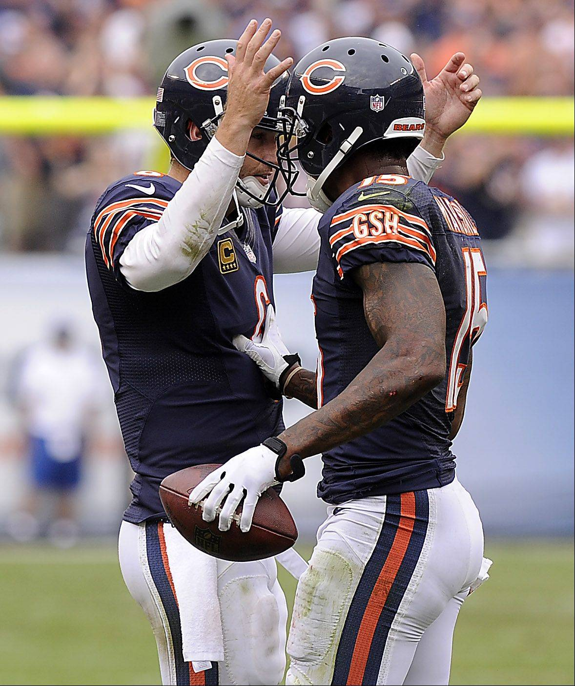 Chicago Bears quarterback Jay Cutler and Brandon Marshall celebrate Marshall's fourth quarter touchdown in the season opener against the Cincinnati Bengals at Soldier Field in Chicago.