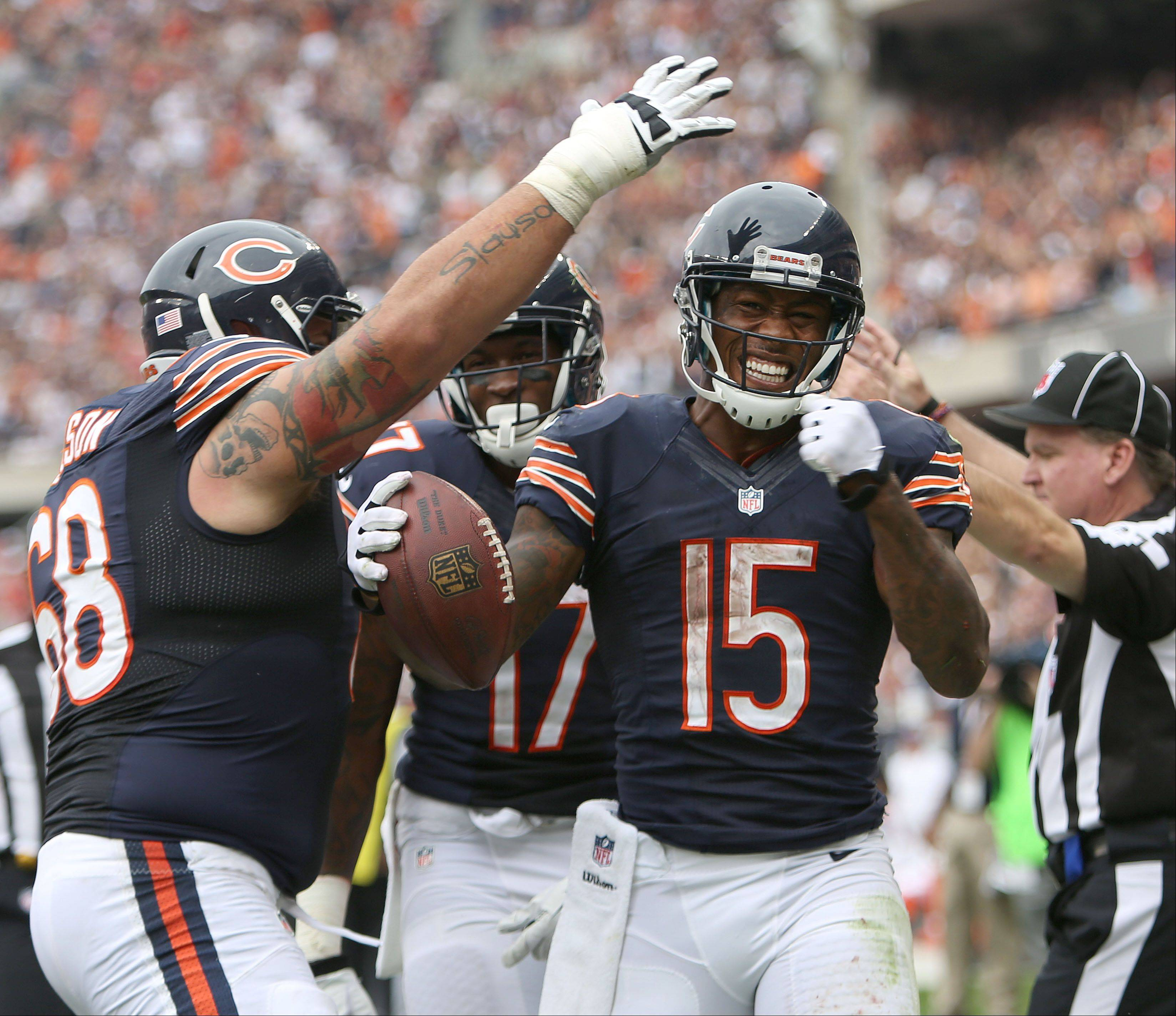 Chicago Bears wide receiver Brandon Marshall celebrates with Chicago Bears guard Matt Slauson after his touchdown catch in the 4th quarter during their opening day win over the Bengals Sunday at Soldier Field in Chicago.