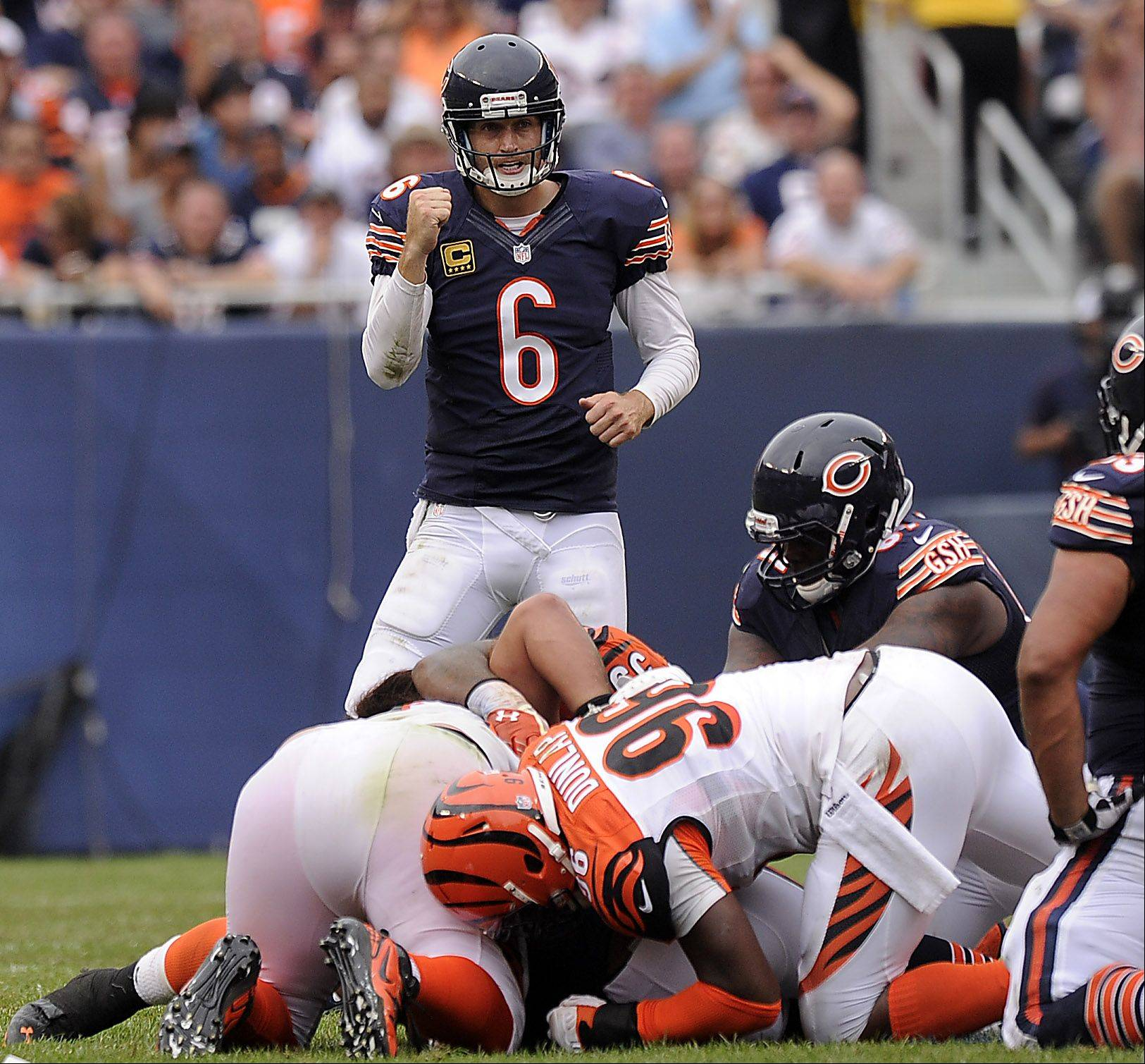 Chicago Bears Jay Cutler pumps his fist after getting a first down in the fourth quarter in the season opener against the Cincinnati Bengals at Soldier Field.