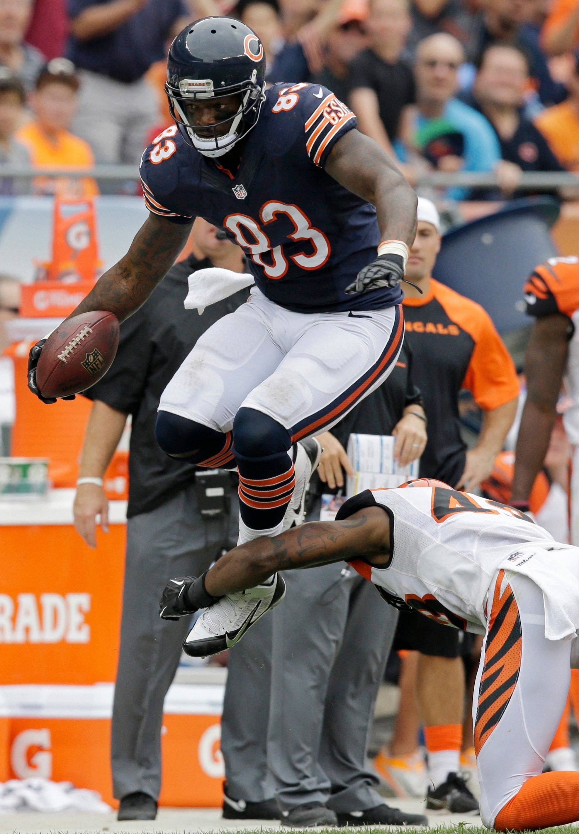 Chicago Bears tight end Martellus Bennett (83) leaps to avoid a tackle by Cincinnati Bengals safety George Iloka (43) during the second half of an NFL football game, Sunday.
