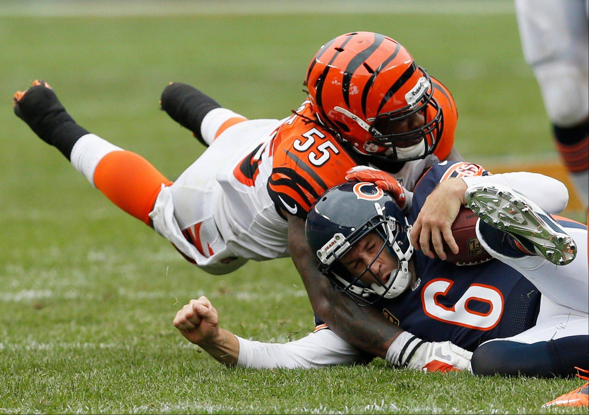 Cincinnati Bengals linebacker Vontaze Burfict (55) runs into Chicago Bears quarterback Jay Cutler as Cutler slides for yardage during the second half of an NFL football game, Sunday, Sept. 8, 2013, in Chicago. The Bears won 24-21.