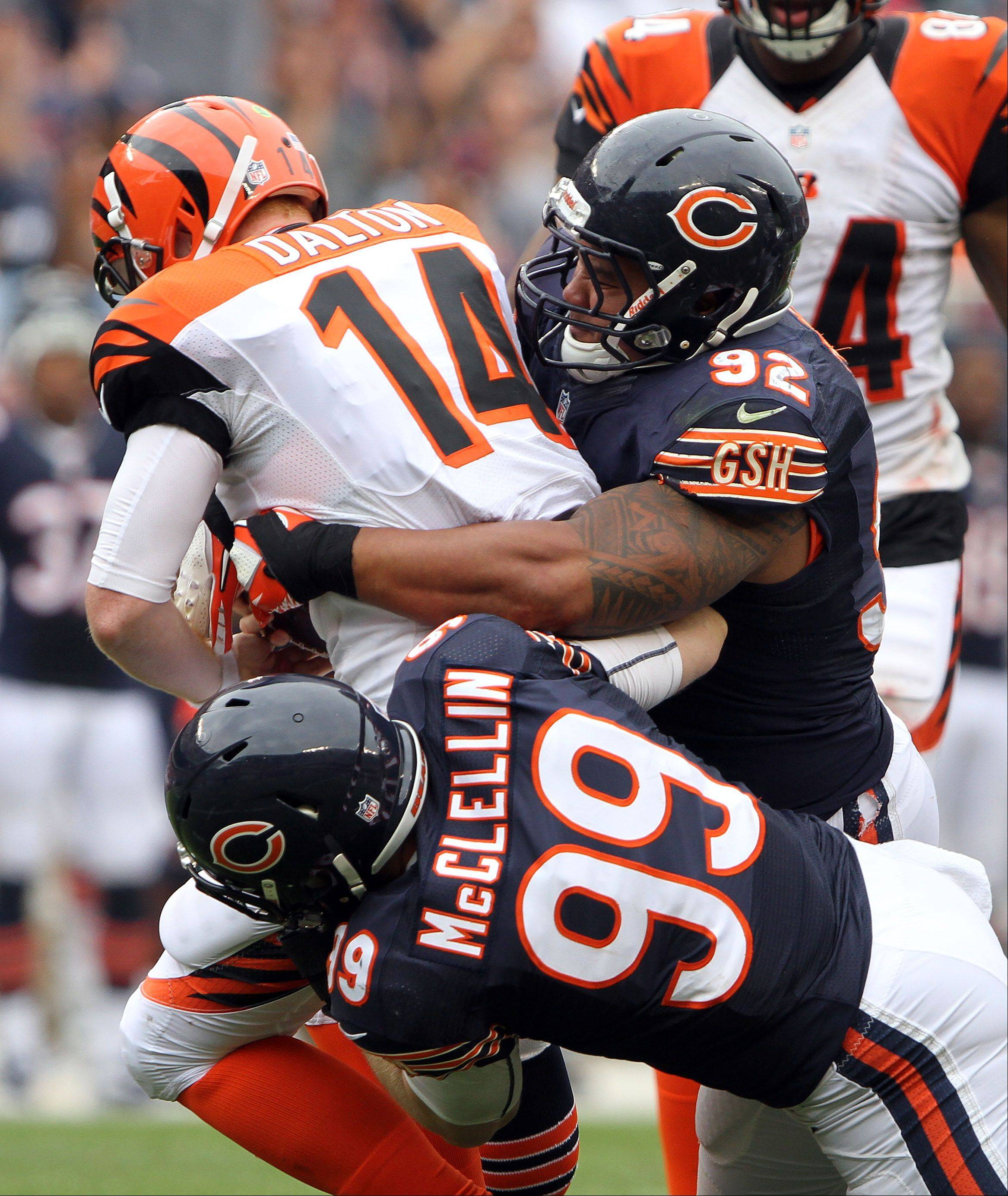 Steve Lundy/slundy@dailyherald.comChicago Bears defensive end Shea McClellin and Chicago Bears defensive tackle Stephen Paea sack Cincinnati Bengals quarterback Andy Dalton during their opening day game Sunday at Soldier Field.