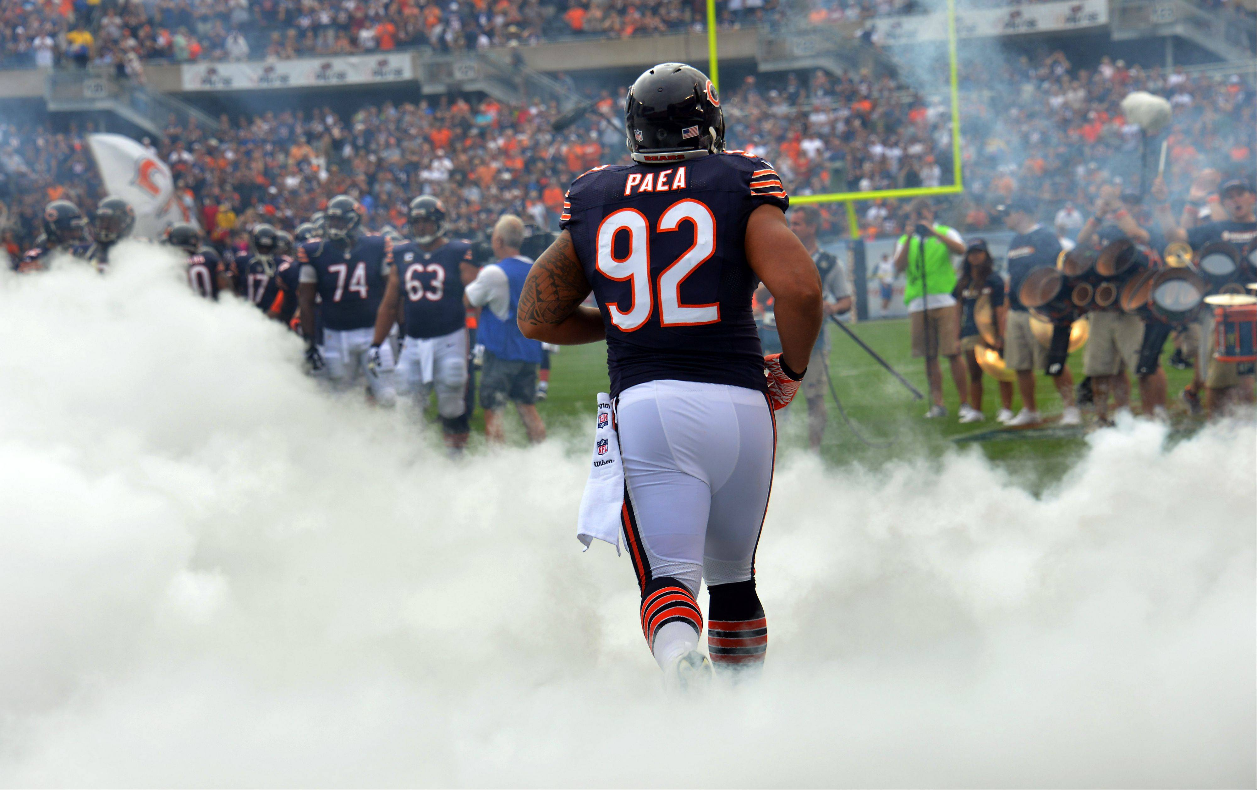 Chicago Bears Stephen Paea and the rest of the Bears take the field in the season opener against the Cincinnati Bengals at Soldier Field in Chicago on Sunday.