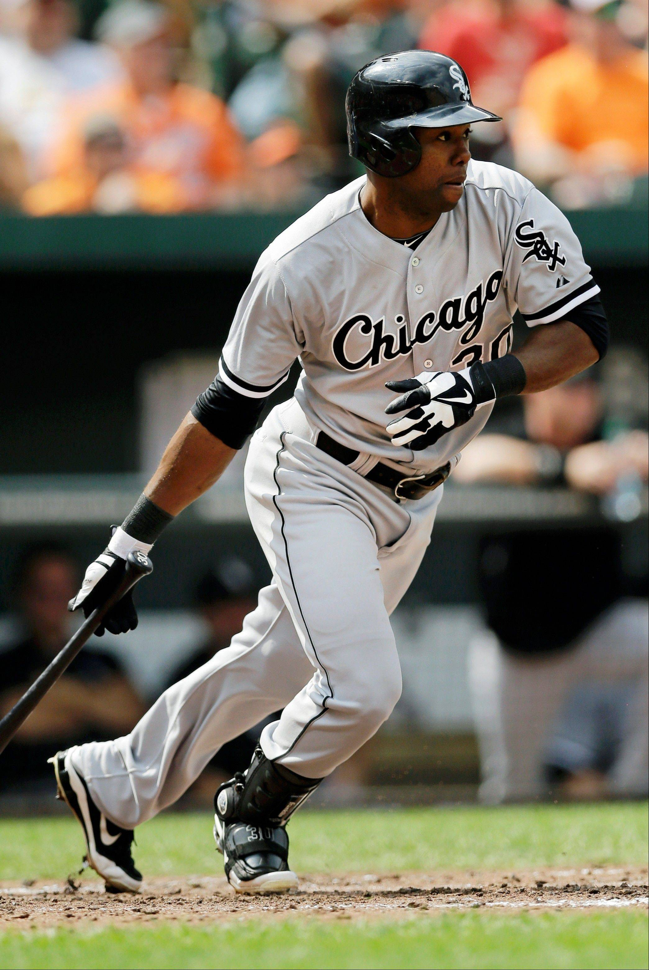 Chicago White Sox' Alejandro De Aza watches his base hit in the fourth inning of a baseball game against the Baltimore Orioles, Sunday, Sept. 8, 2013, in Baltimore. Jeff Keppinger scored on the play.