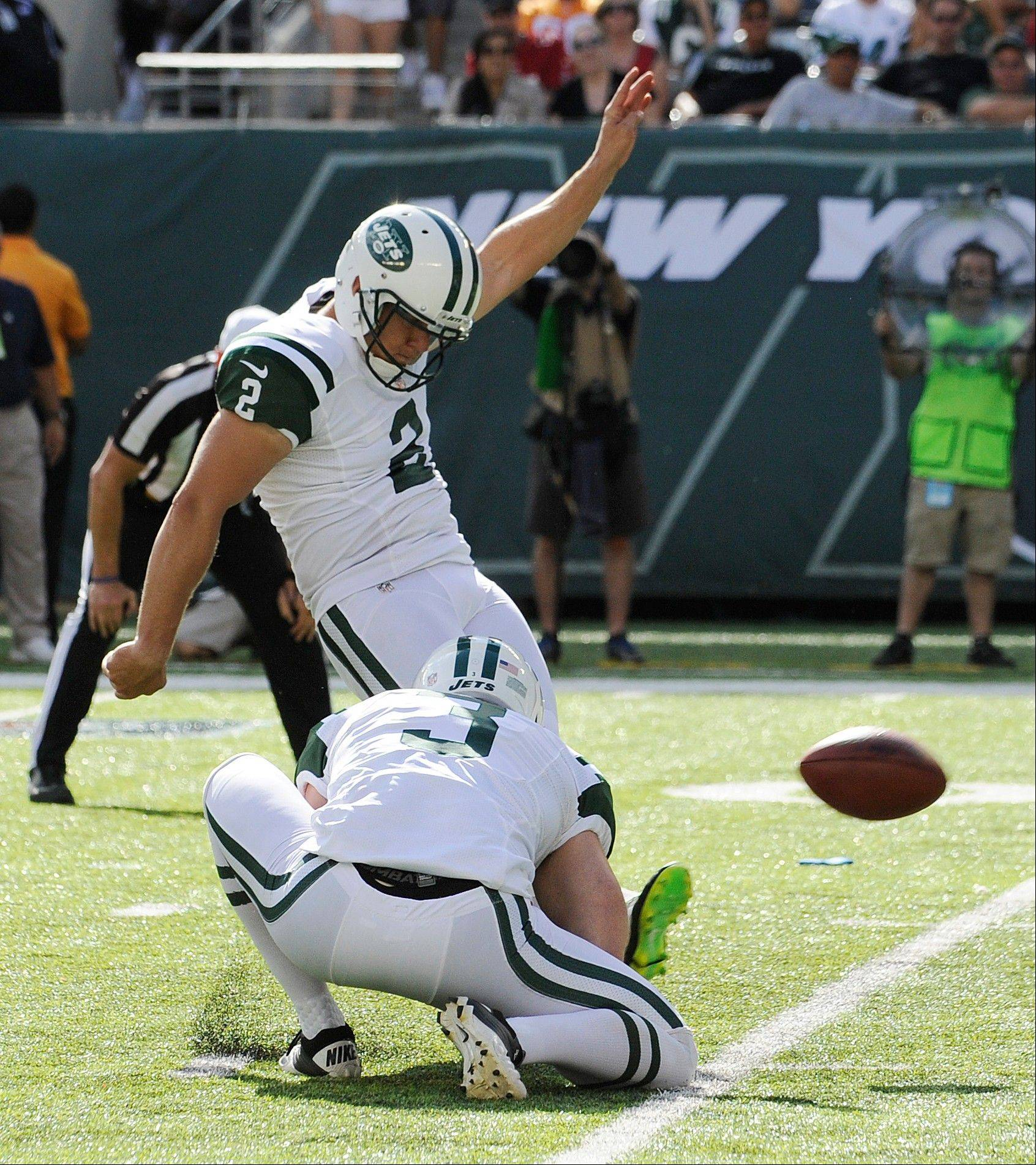 New York Jets' Nick Folk (2) kicks a 30-yard field goal as Robert Malone (3) holds in the second half of an NFL football game against the Tampa Bay Buccaneers, Sunday, Sept. 8, 2013, in East Rutherford, N.J.