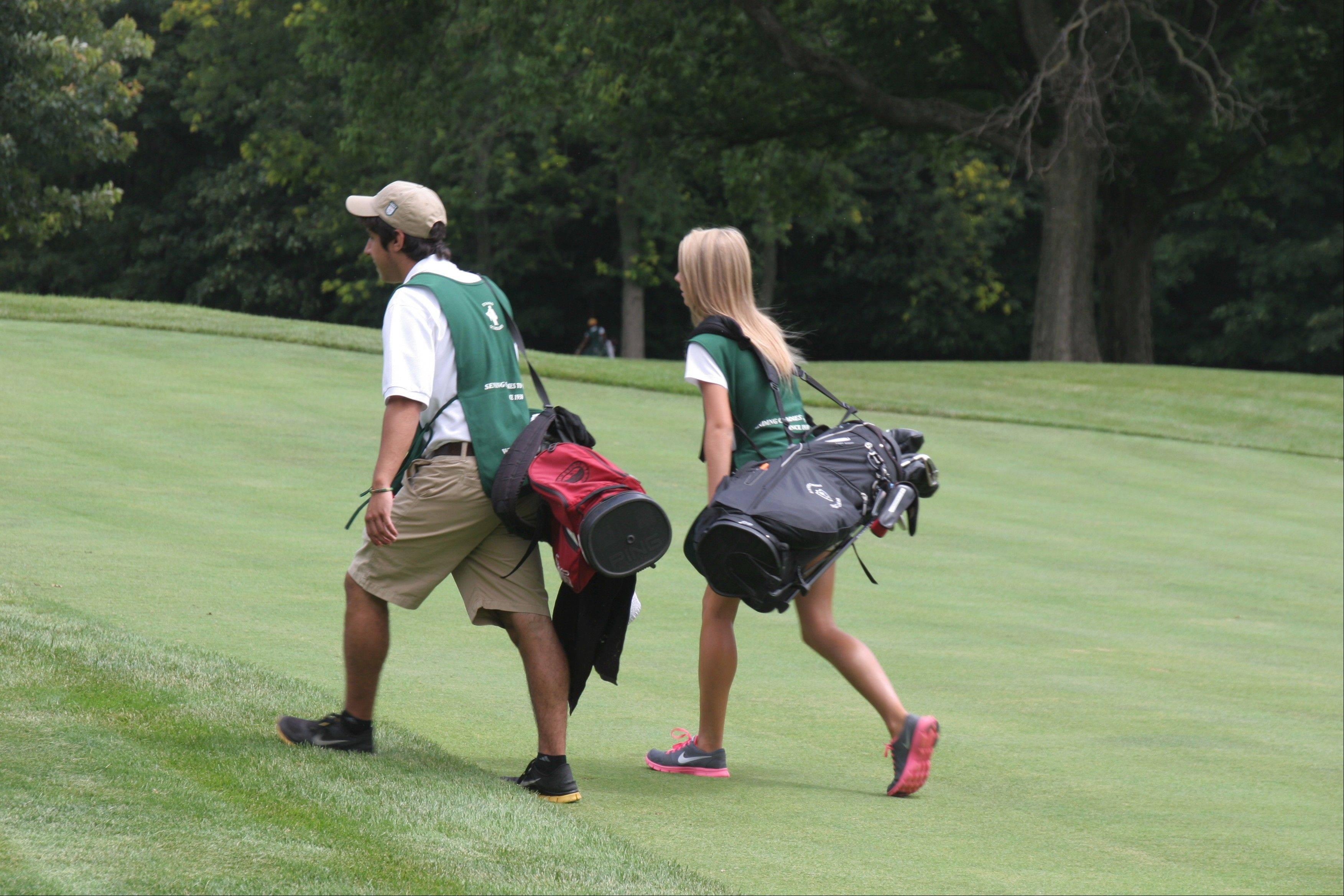 Fundraising efforts and support for this week's BMW Championship at Conway Farms Golf Club will provide support for 240 college cholarships awarded to caddies through the Evans Scholars Foundation.