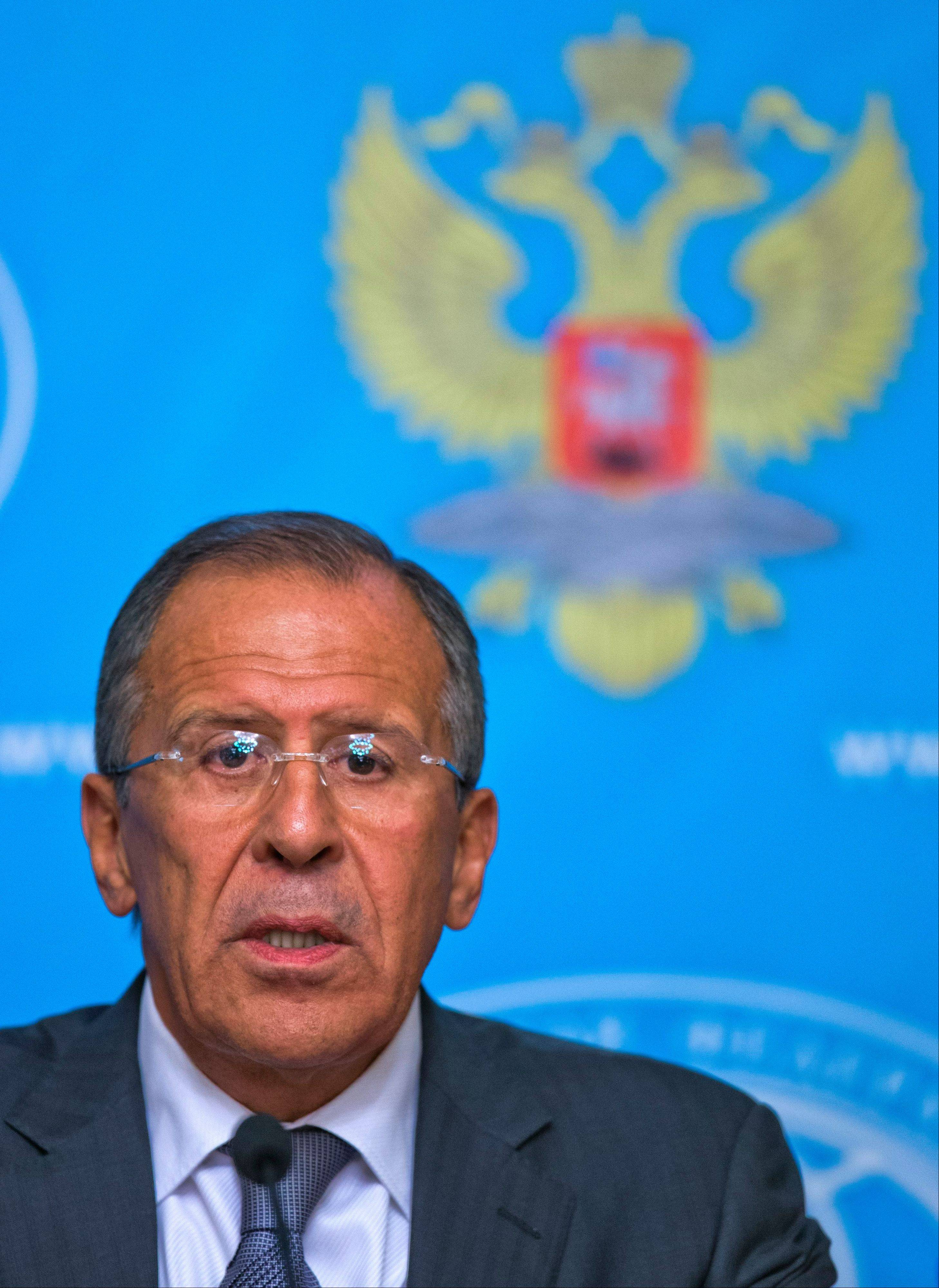 Russian Foreign Minister Sergey Lavrov speaks Monday at a news conference in Moscow. The Russian Foreign Minister says Moscow will push Syria to place its chemical weapons under international control. Sergey Lavrov said Monday that if such a move would help avert a possible U.S. strike on Syria, Russia will start work �immediately� to persuade Syria to relinquish control over its chemical arsenals.
