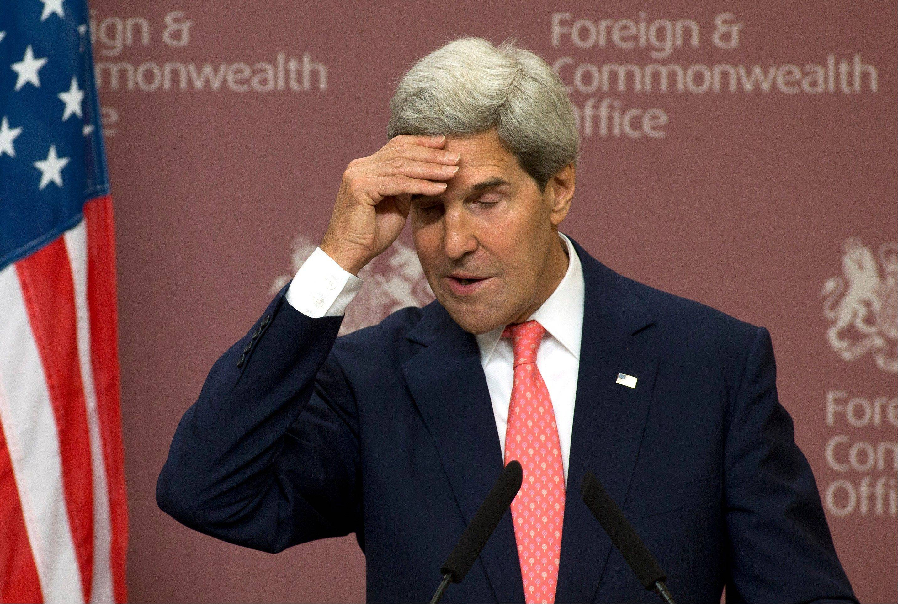 Kerry reasserts Syria charge despite Assad denial