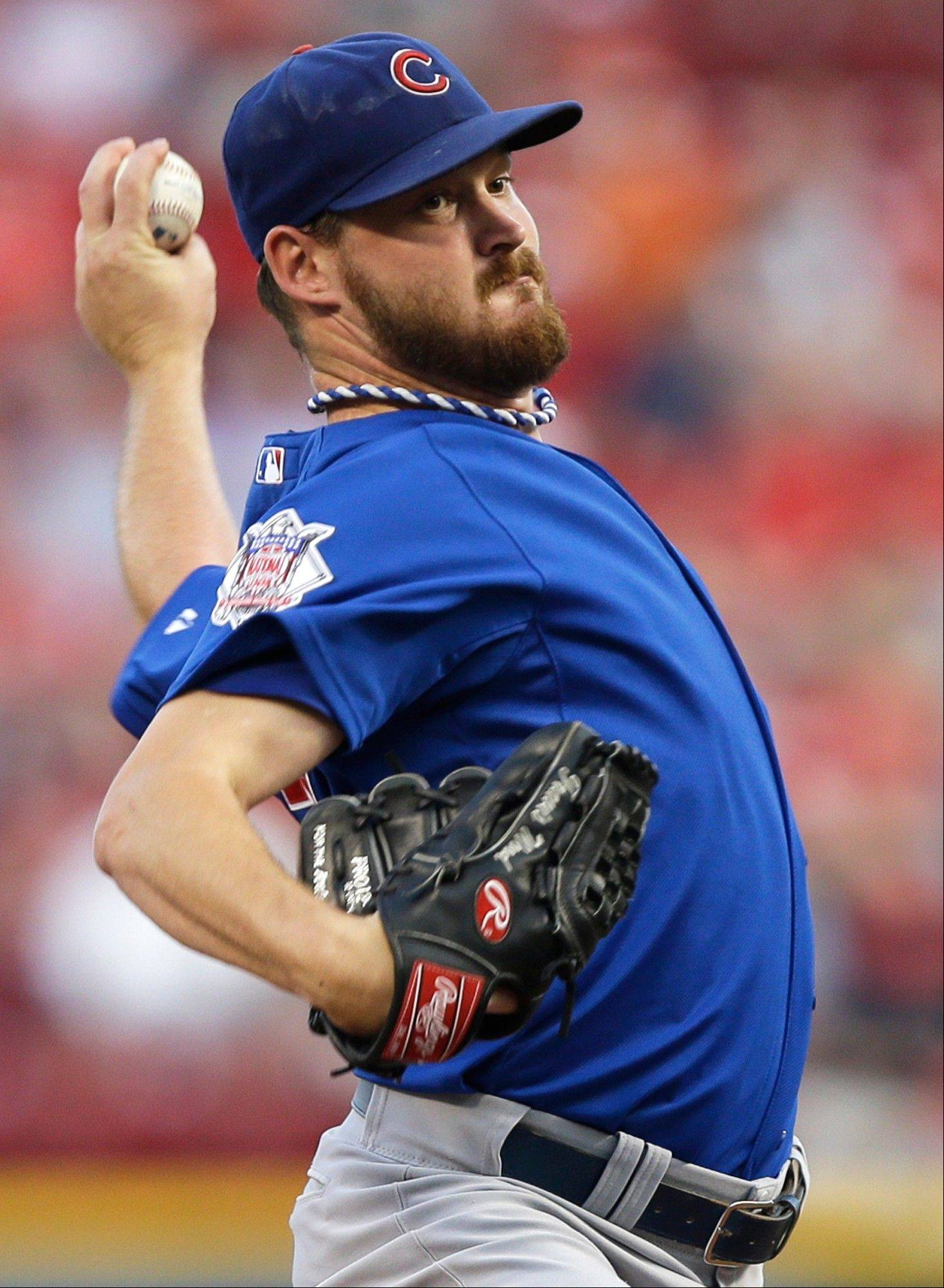 Cubs starting pitcher Travis Wood throws against the Reds, his former team, in the first inning Monday in Cincinnati.