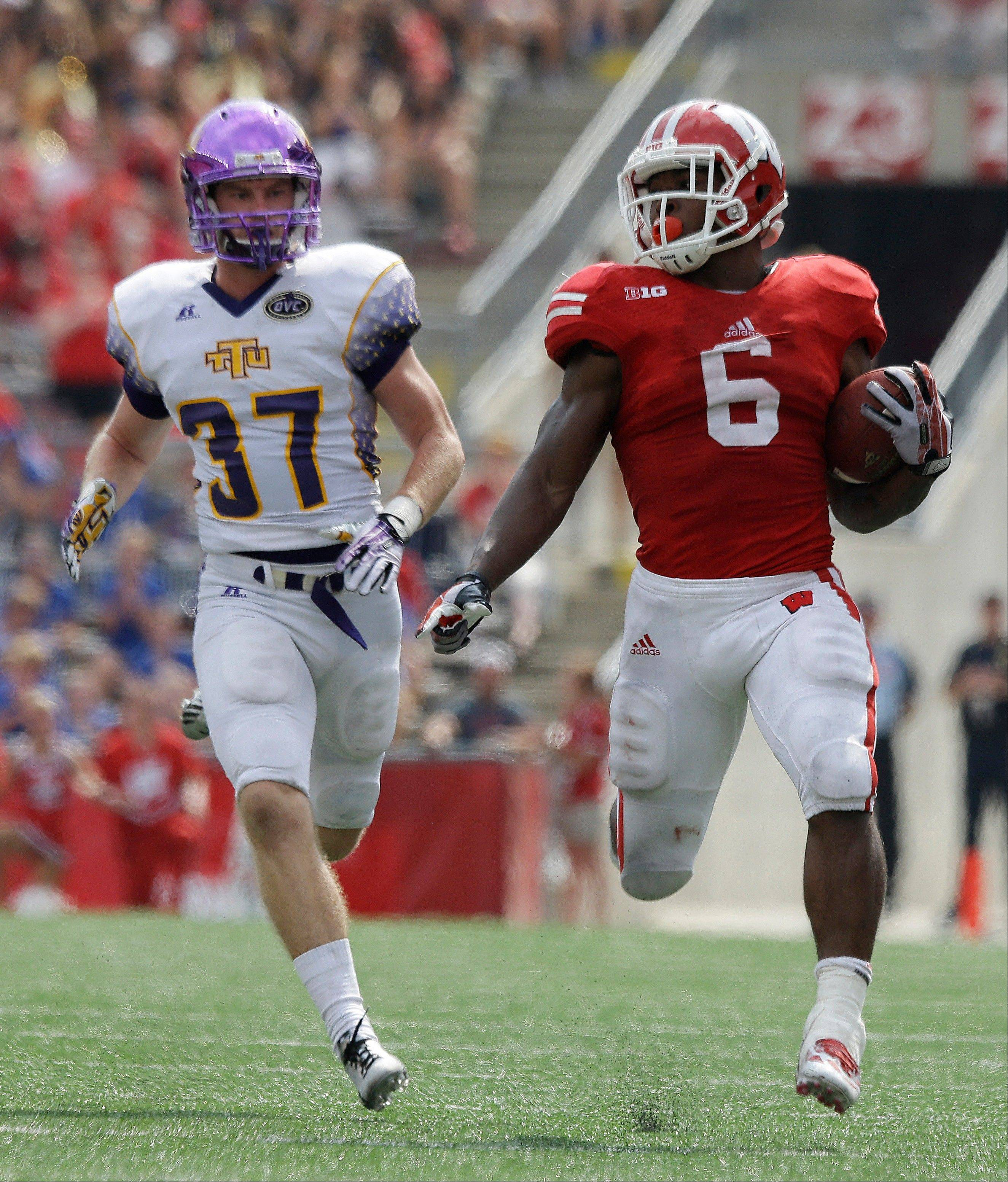 Wisconsin�s Corey Clement breaks away from Tennessee Tech�s Patrick Prewitt for a 75-yard touchdown run during the second half of last Saturday�s game in Madison, Wis. The Badgers will face a much tougher test this Saturday at Arizona State.