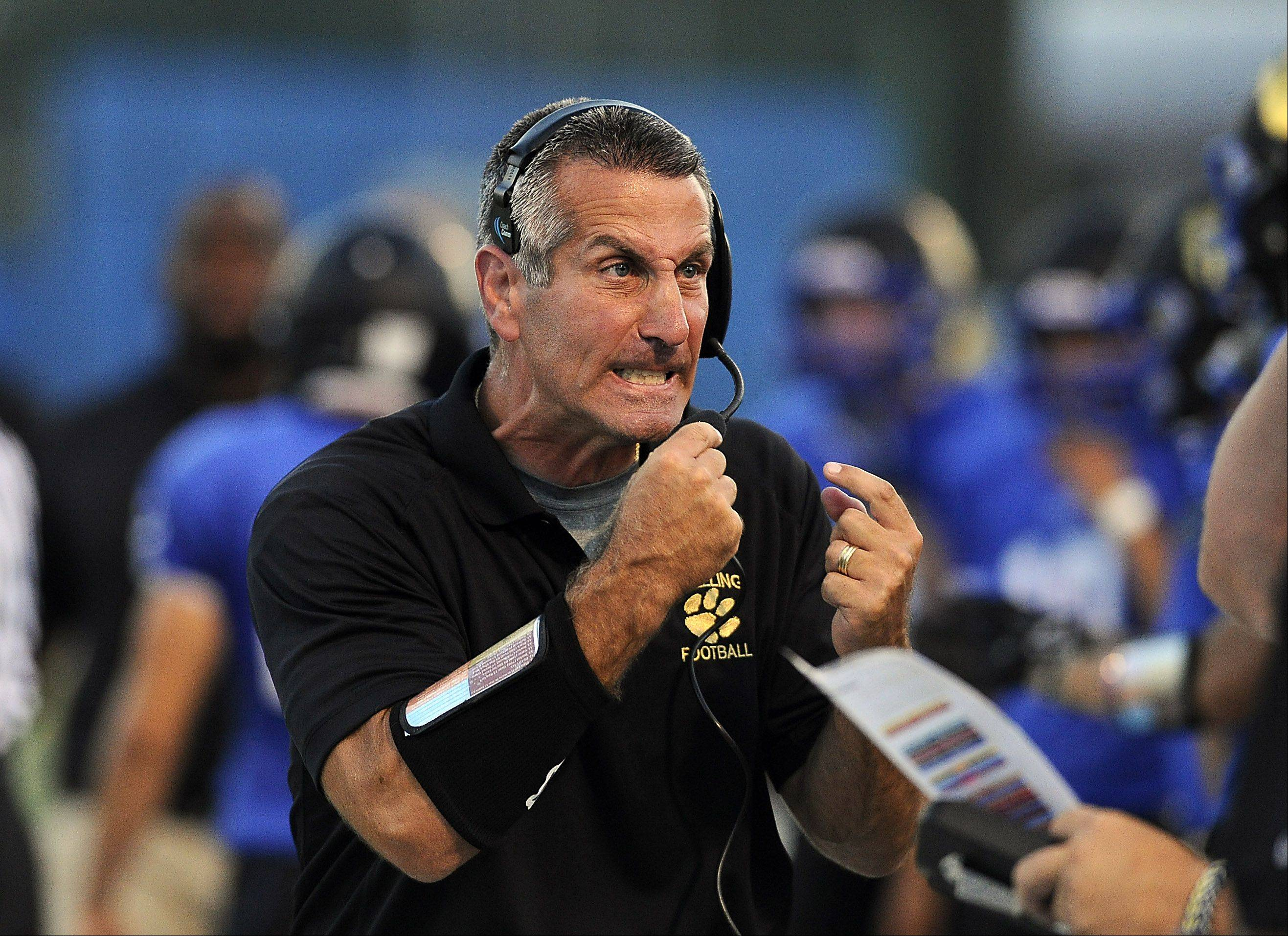 Wheeling head football coach Brent Pearlman gets fired up during Friday's home game against Schaumburg.