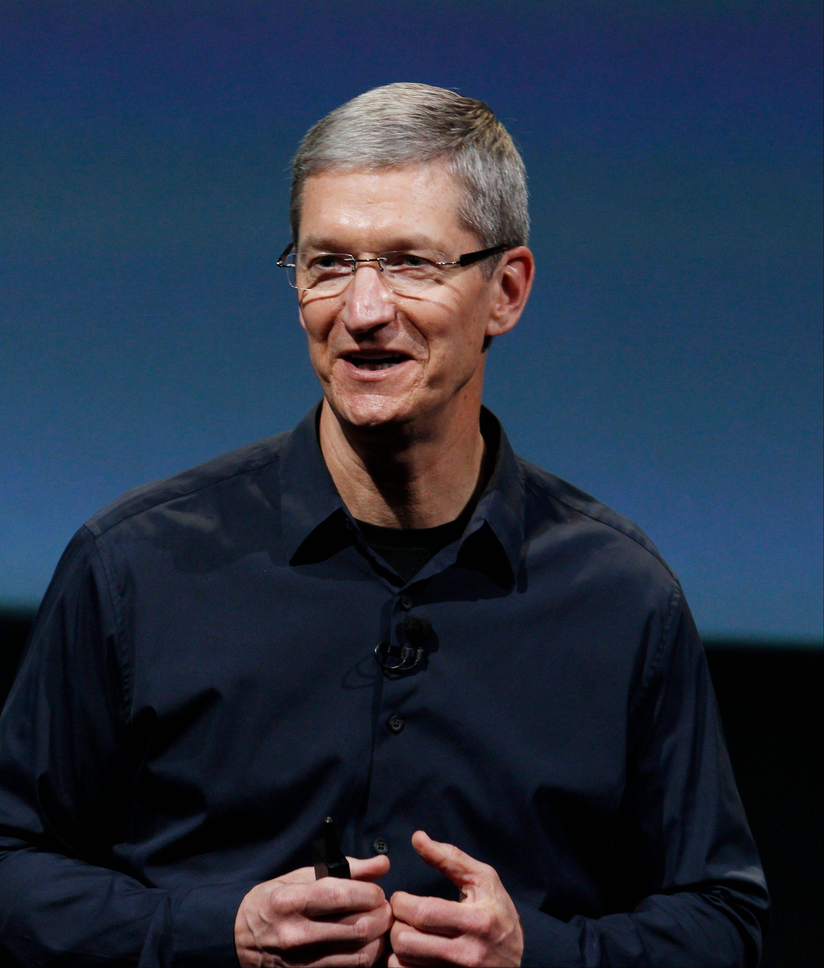 Apple CEO Tim Cook, seen here during a product announcement in 2011, is facing some pressure to maintain a company that under late founder Steve Jobs was a leader in the tech field.