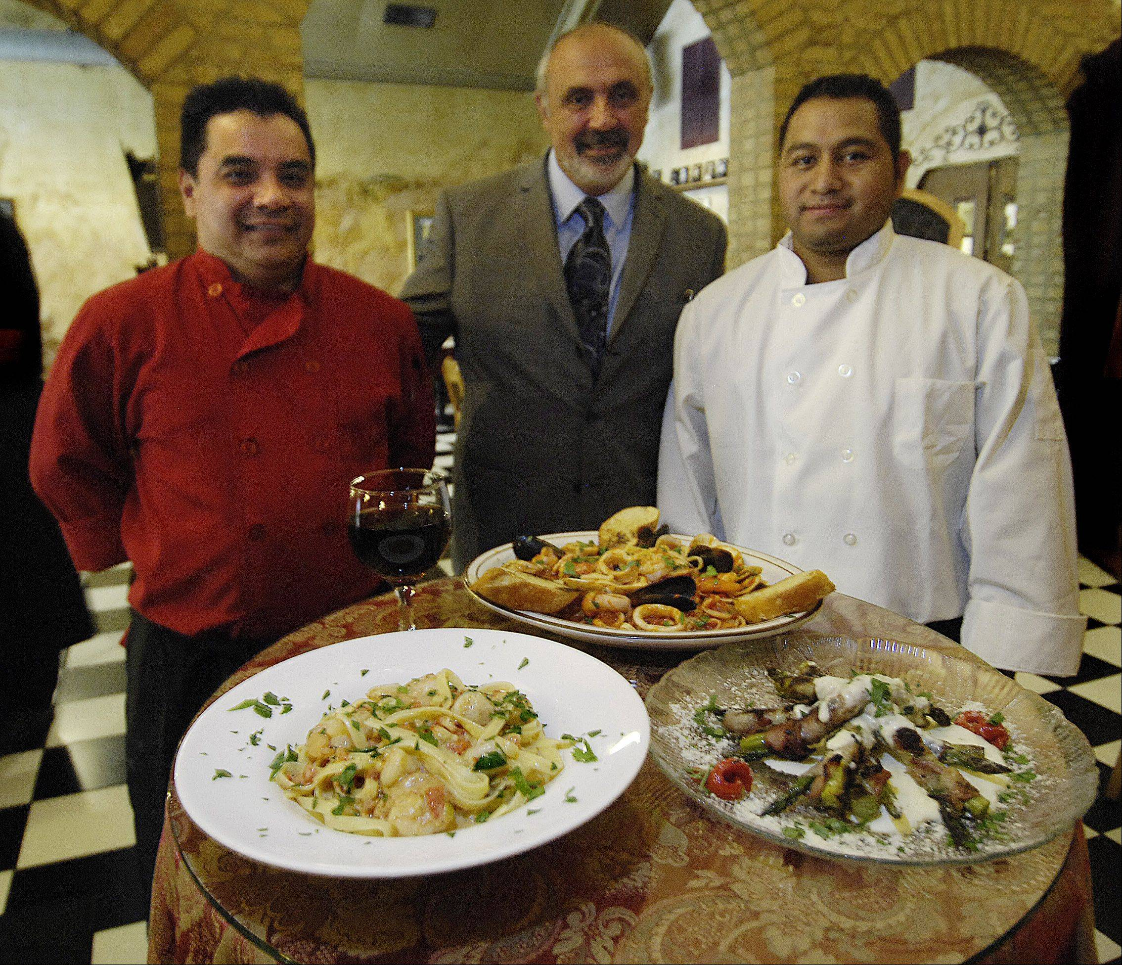 Villa Verone owner Pietro Verone, center, has closed his Elgin store.