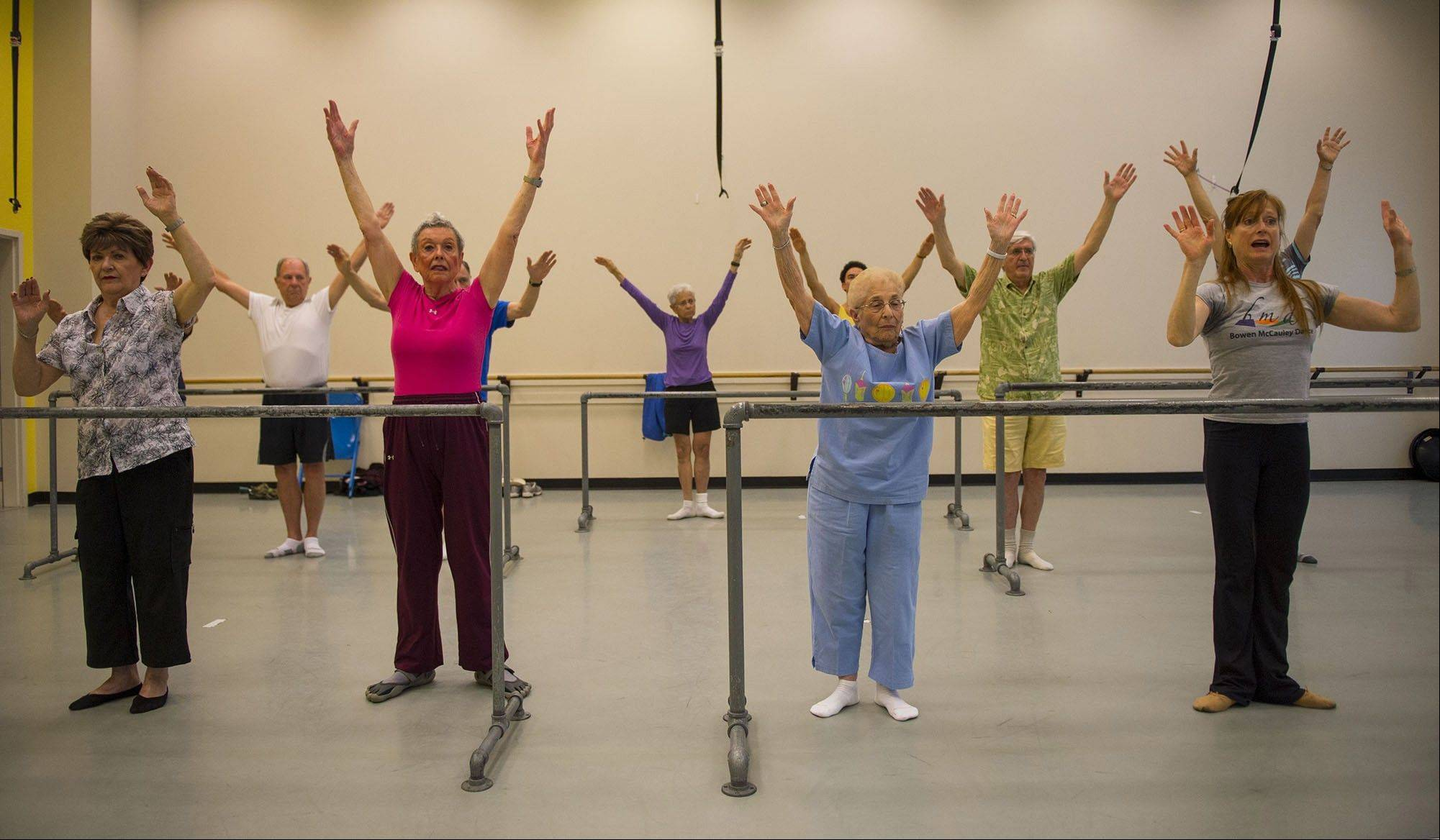 Dance instructor Lucy Bowen McCauley, right, leads her group of seniors in a variety of dance exercises during the Dance for Parkinson's Disease class at the Maryland Youth Ballet in Silver Spring, Md.