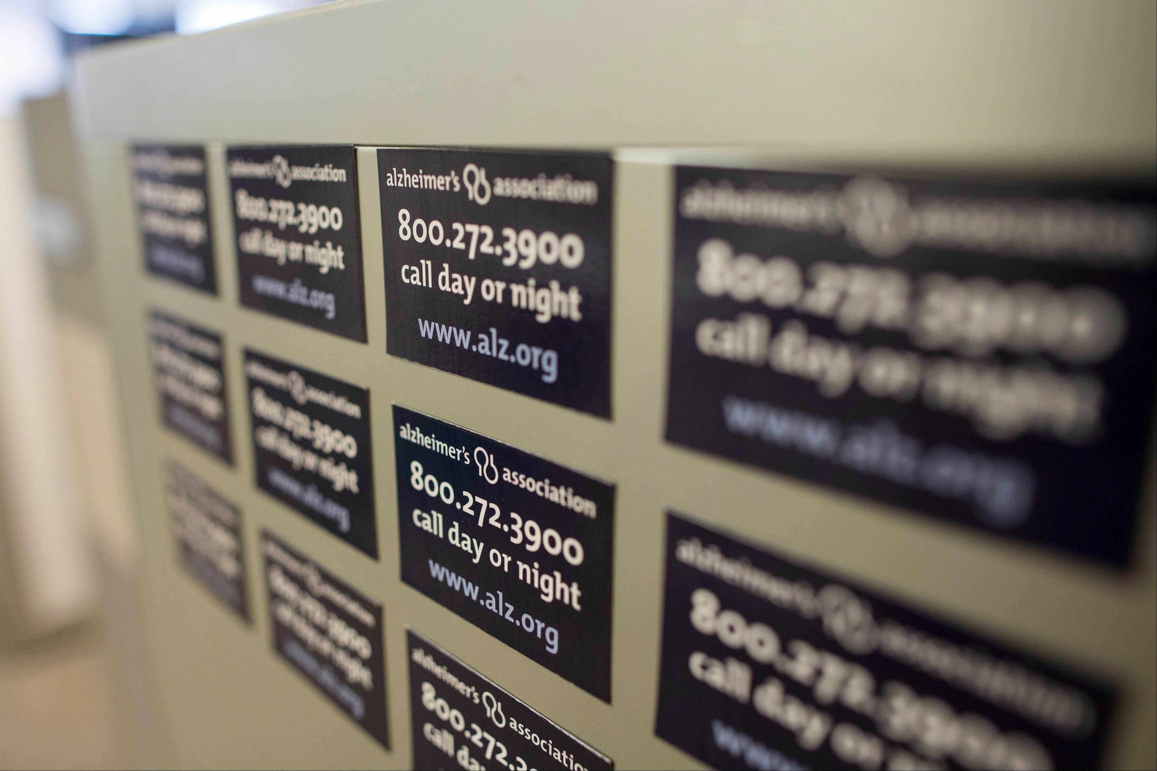 "Magnets on a cabinet at the Alzheimer's Association Headquarters in Chicago advertising their help line. Doctors often regard people who complain that their memory is slipping as ""the worried well,"" but the new studies show they may well have reason to worry, said Maria Carrillo, a senior scientist at the Alzheimer's Association."
