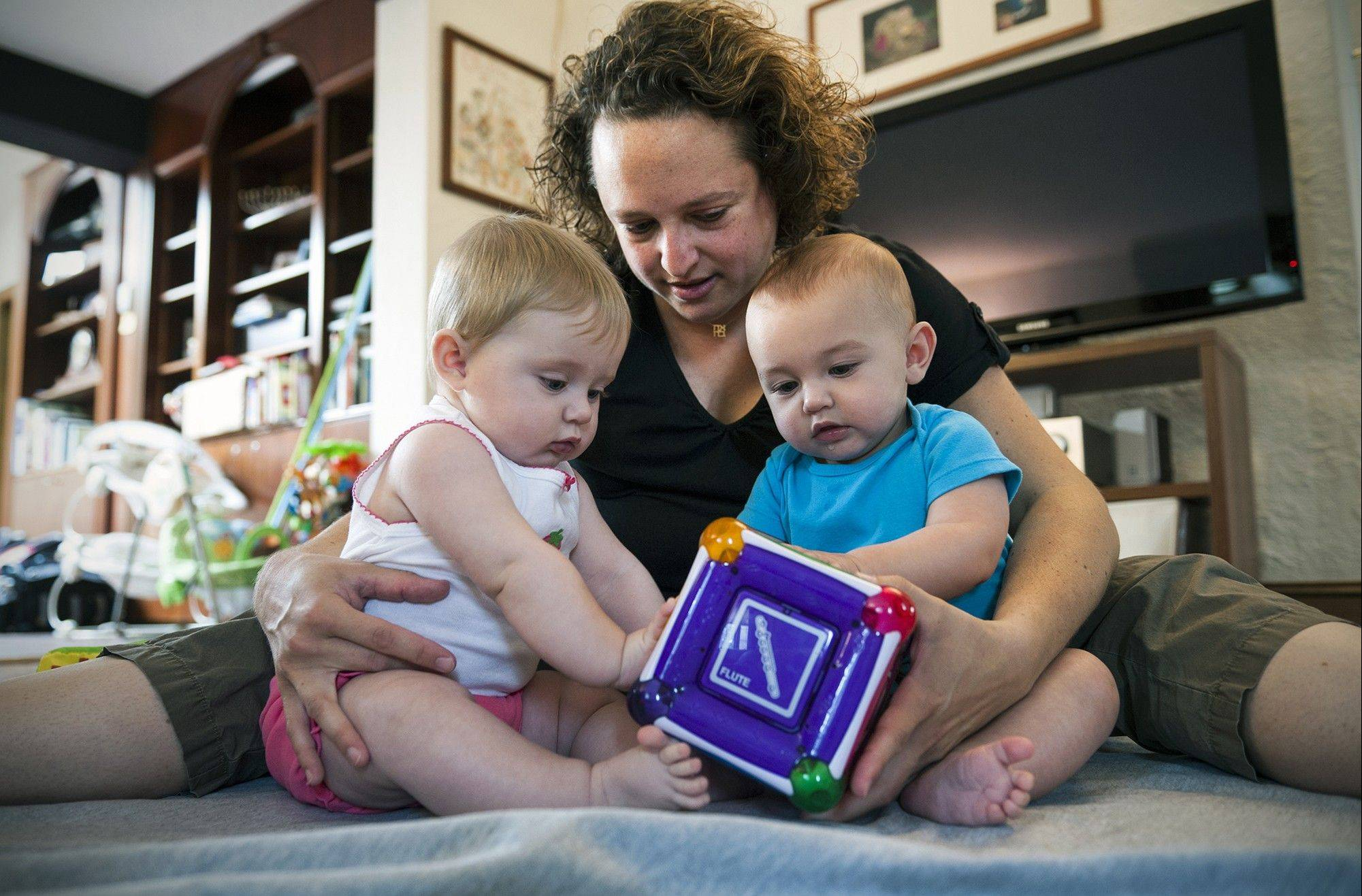 Ilana Brunner had her eggs frozen before her double mastectomy and again before chemotherapy. Neither step led to a pregnancy. But she later retrieved eggs that were fertilized with her husband's sperm, resulting in the birth of twins Lyla, left, and Aryeh.