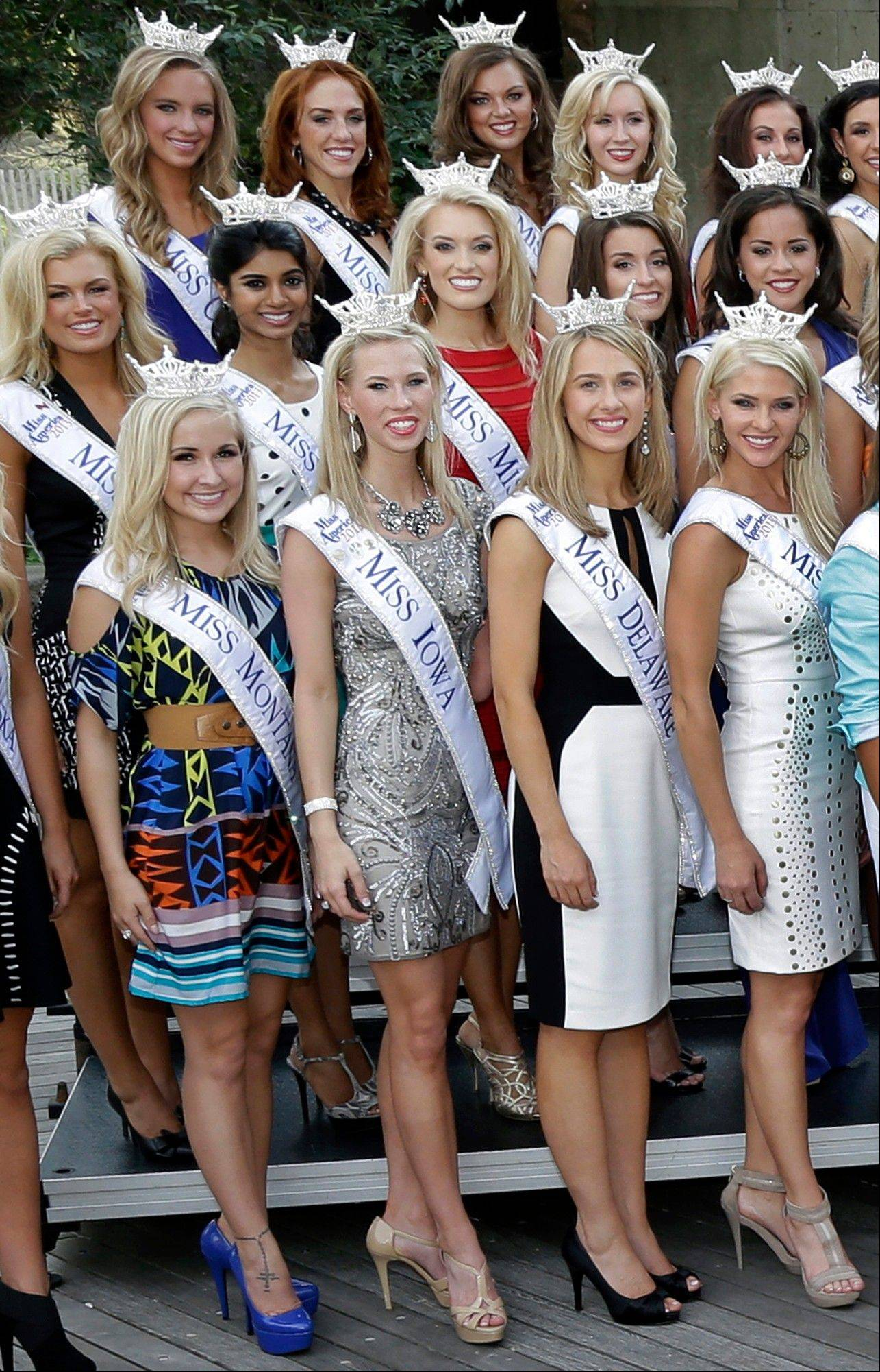 Miss Iowa, Nicole Kelly, front row, second from left, stands with other Miss America contestants during arrival ceremonies in Atlantic City, N.J., last week.