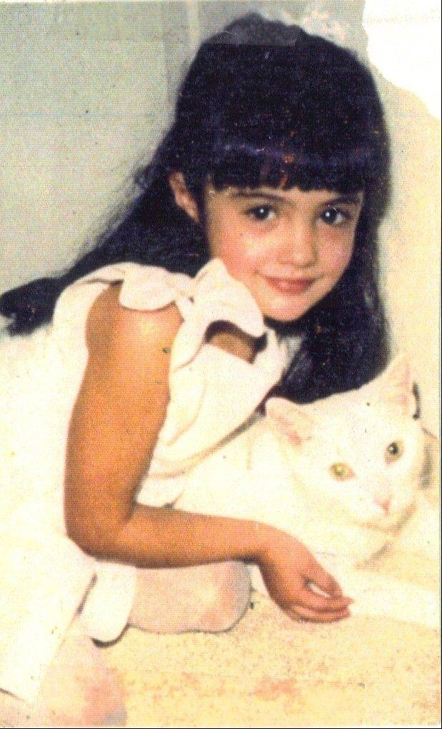 A childhood photo of model, actress and animal rights advocate Katie Cleary, of Glenview, shows her with one of her beloved cats.