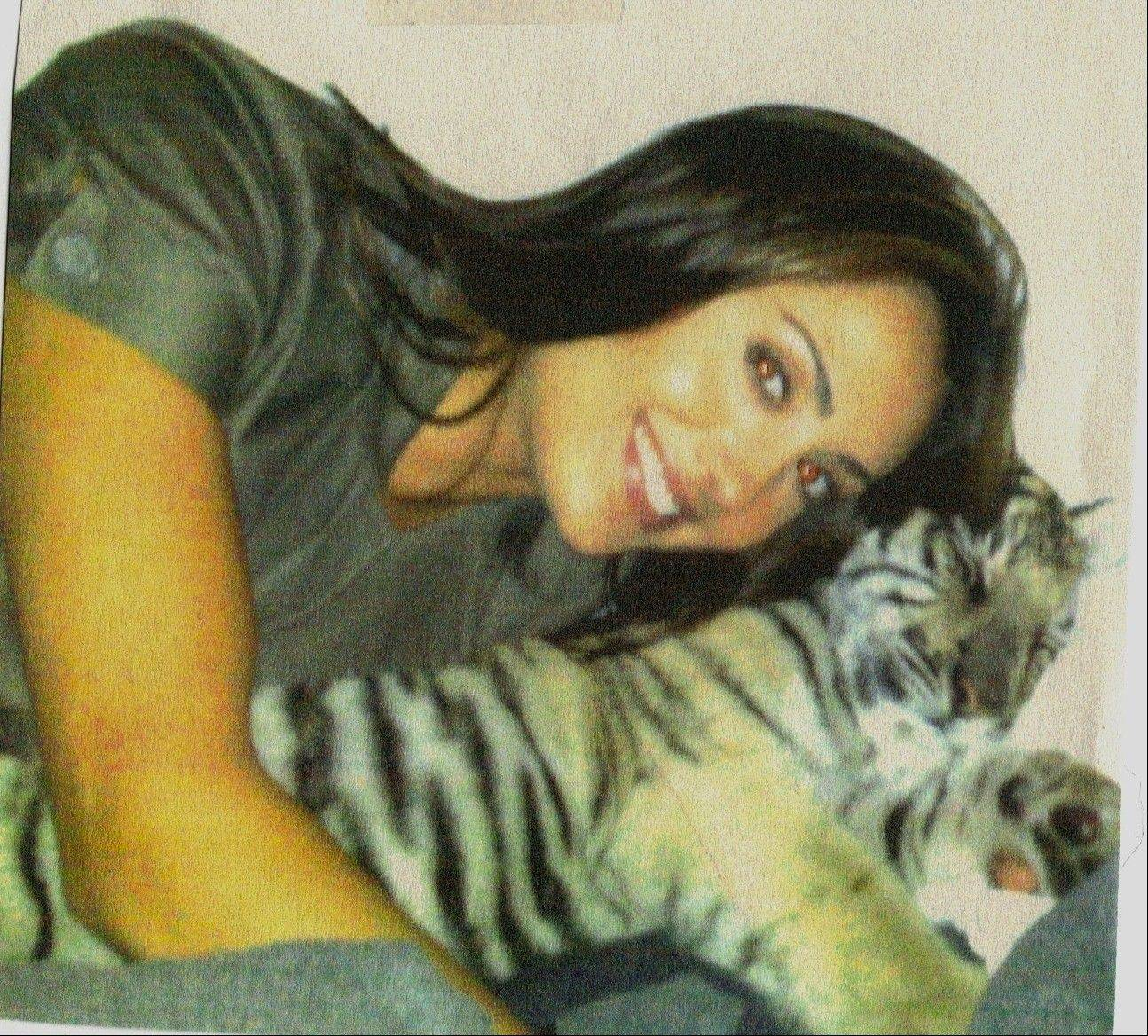 Model, actress and animal rights advocate Katie Cleary, of Glenview, poses with one of her beloved cats.