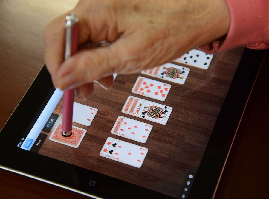 """During the war, I played pinochle with my father and his old cronies,"" remembers Simone Lucas, 89, as she quickly gets the hang of using a special app to play virtual solitaire at Emeritus Senior Living in Hoffman Estates."