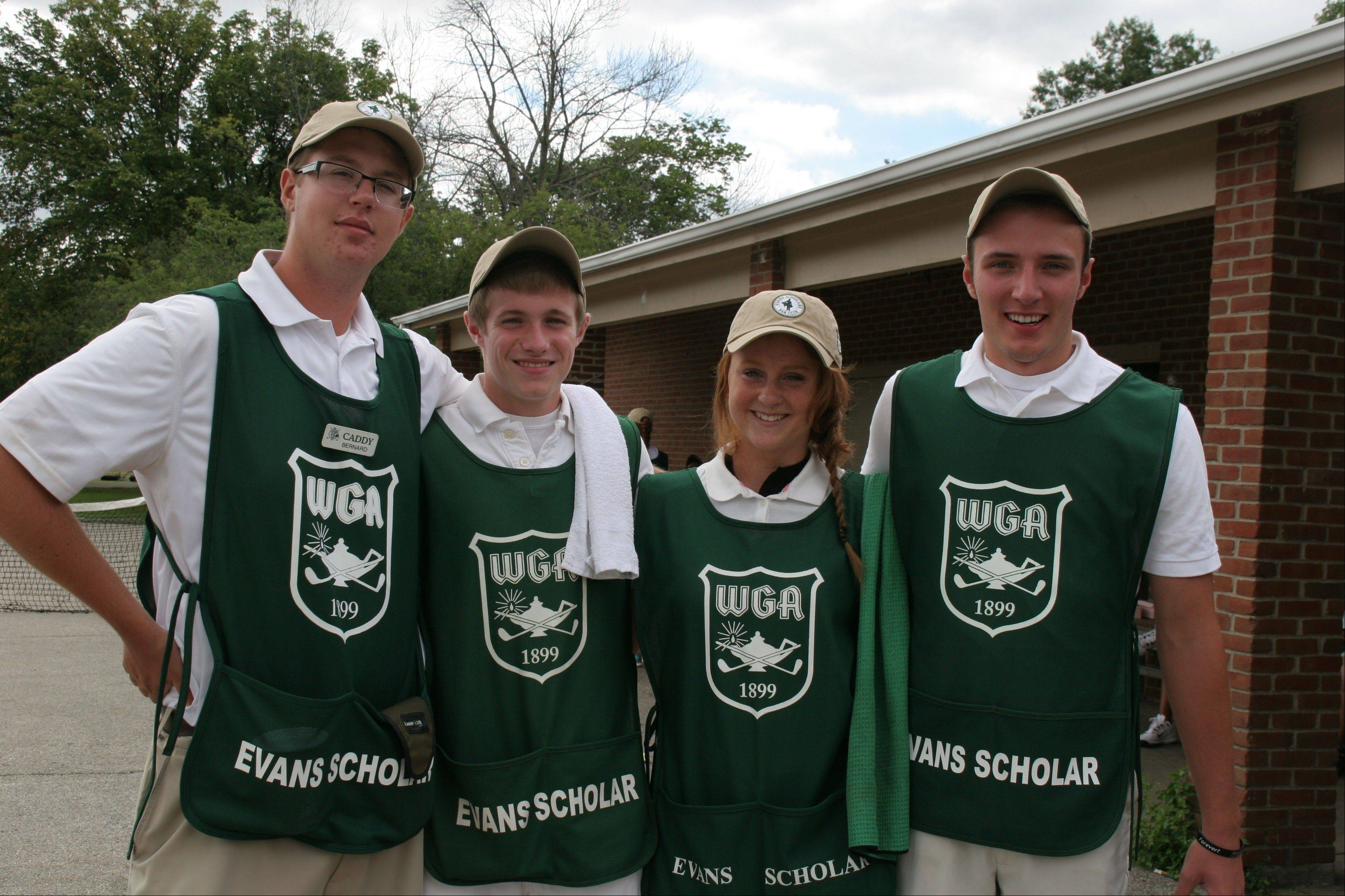 More than 9,000 caddies, including these shown here, have earned four-year Evans Scholarships with the help of the WGA since Chick Evans created the Evans Scholars Foundation in 1930.