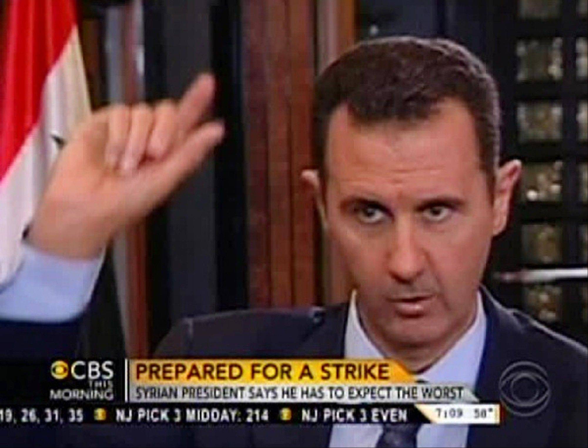 "In this frame grab from video taken Sunday and provided by ""CBS This Morning,"" Syrian President Bashar Assad responds to a question from Charlie Rose during an interview in Damascus, Syria. Assad warned in the interview broadcast Monday on CBS there will be retaliation against the U.S. for any military strike launched in response to the alleged chemical weapons attack. Assad said, ""You should expect everything."""
