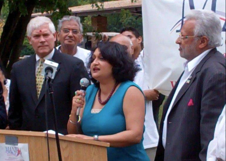 Manju Goel discusses her plans to run as a Republican against Tammy Duckworth in the 8th Congressional District during the Northwest Suburban Republican Family Picnic at Busse Woods Forest Preserve in Elk Grove Village. With her are Texas congressman Pete Sessions, left, and Carol Stream businessman Shalli Kumar.