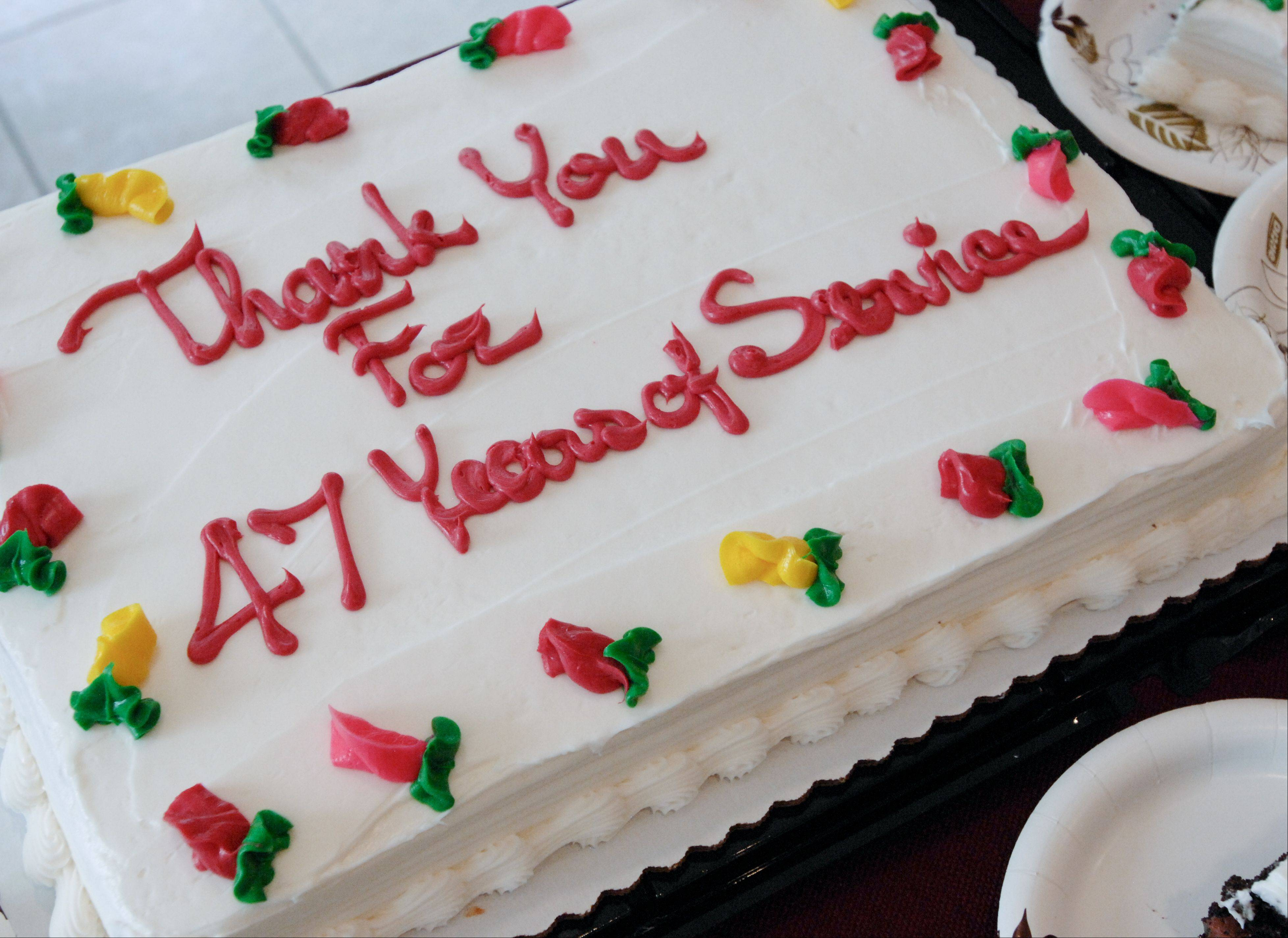 A cake thanking Wheaton Library Director Sarah Meisels for her 47 years of service was part of her retirement celebration Sunday.