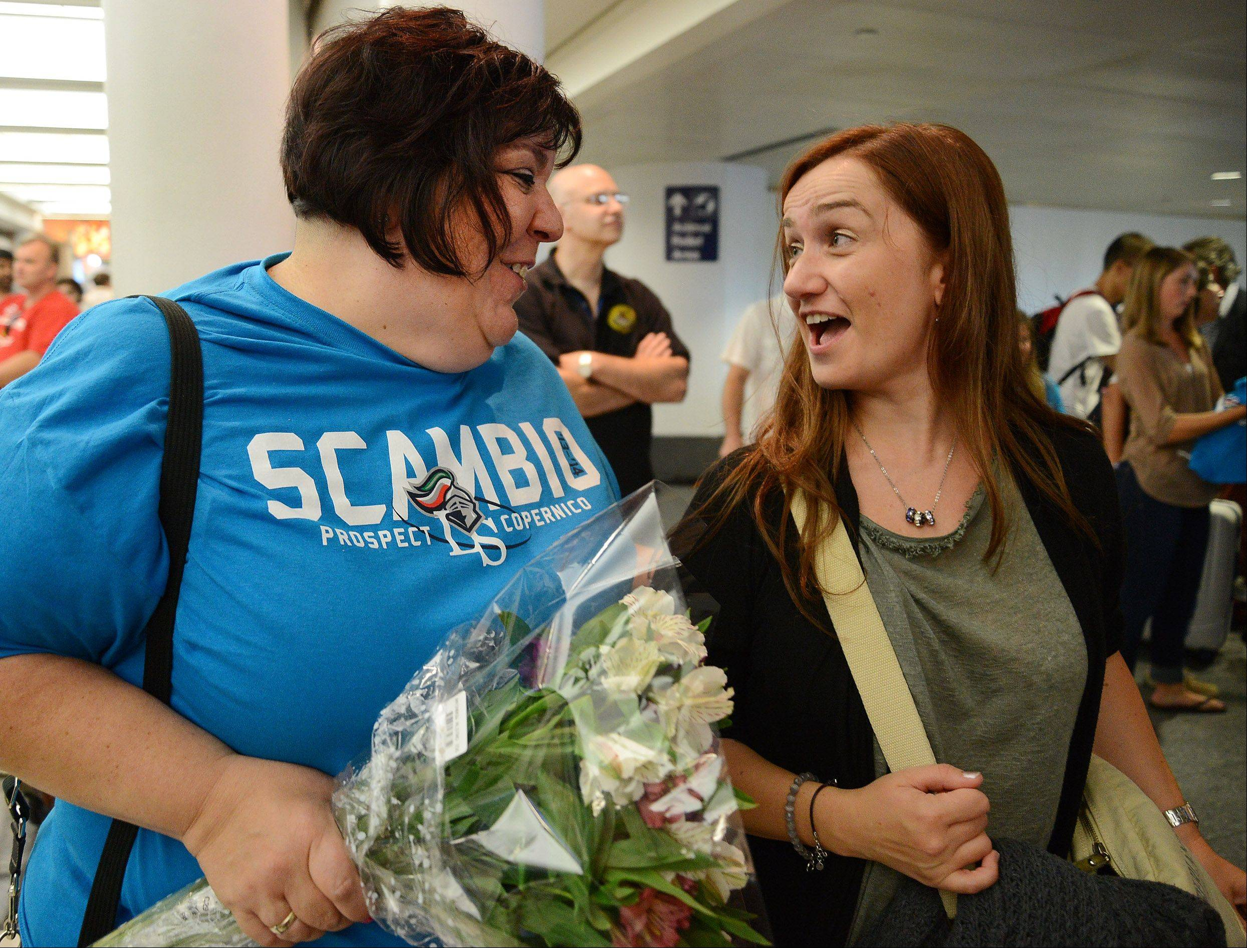 Lyn Scolaro, left, meets her Italian counterpart, math and physics teacher Alessandra Martinelli, as Italian students arrive at O'Hare Thursday for a week's visit.