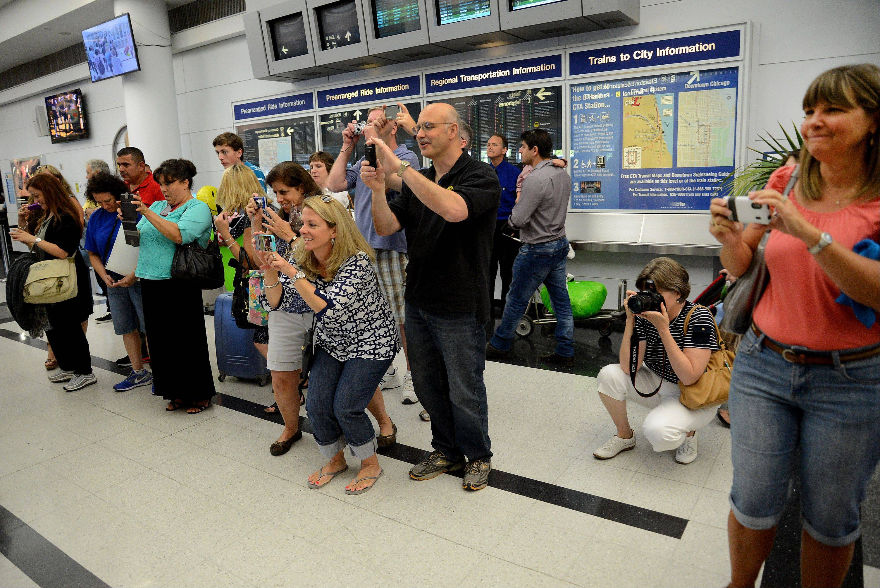Prospect parents snap photos as the students meet up at O'Hare. The students have been communicating since June.