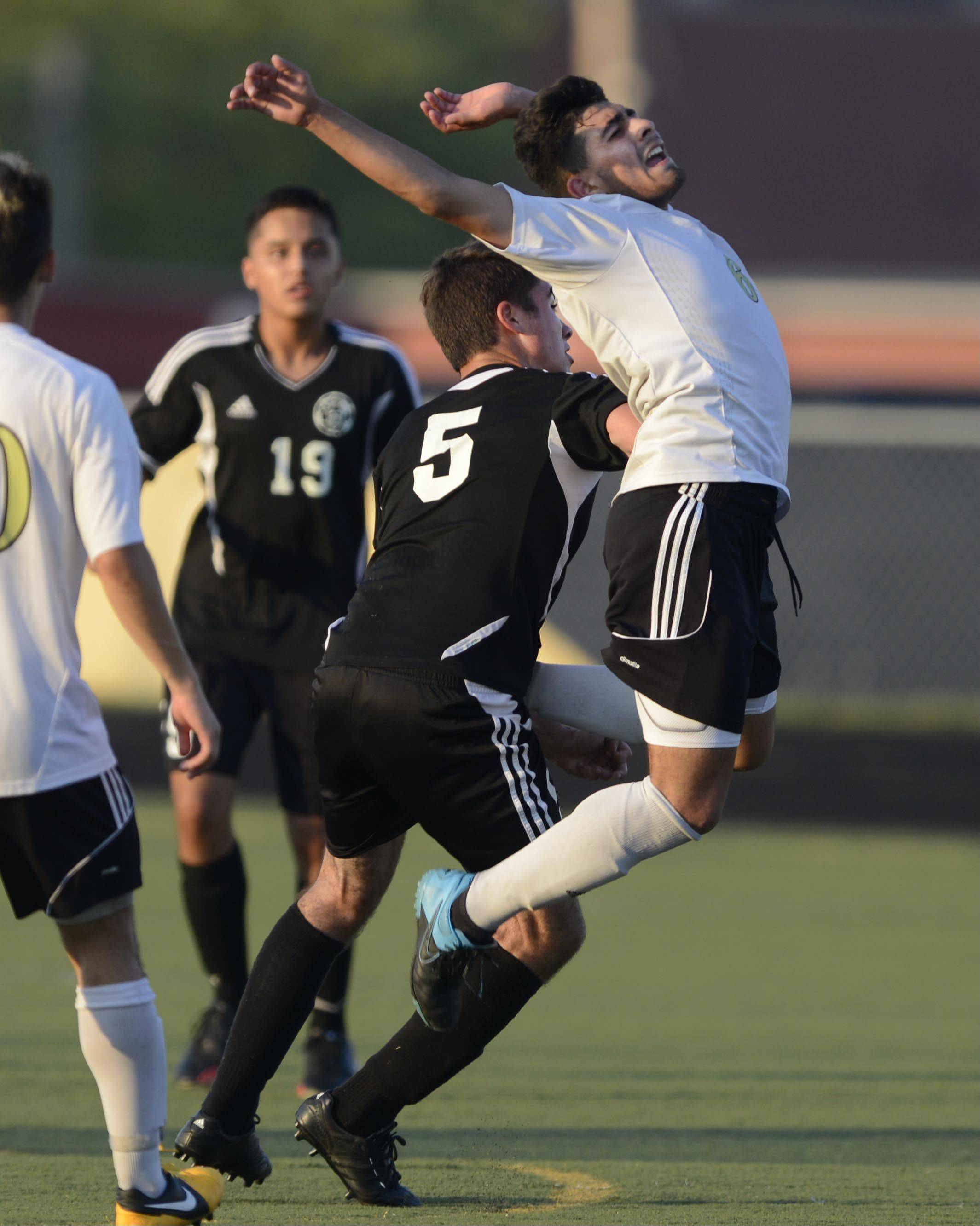 Streamwood's Christian Vences gets shoved away from a header by Kaneland's Anthony Parillo Monday in Streamwood.