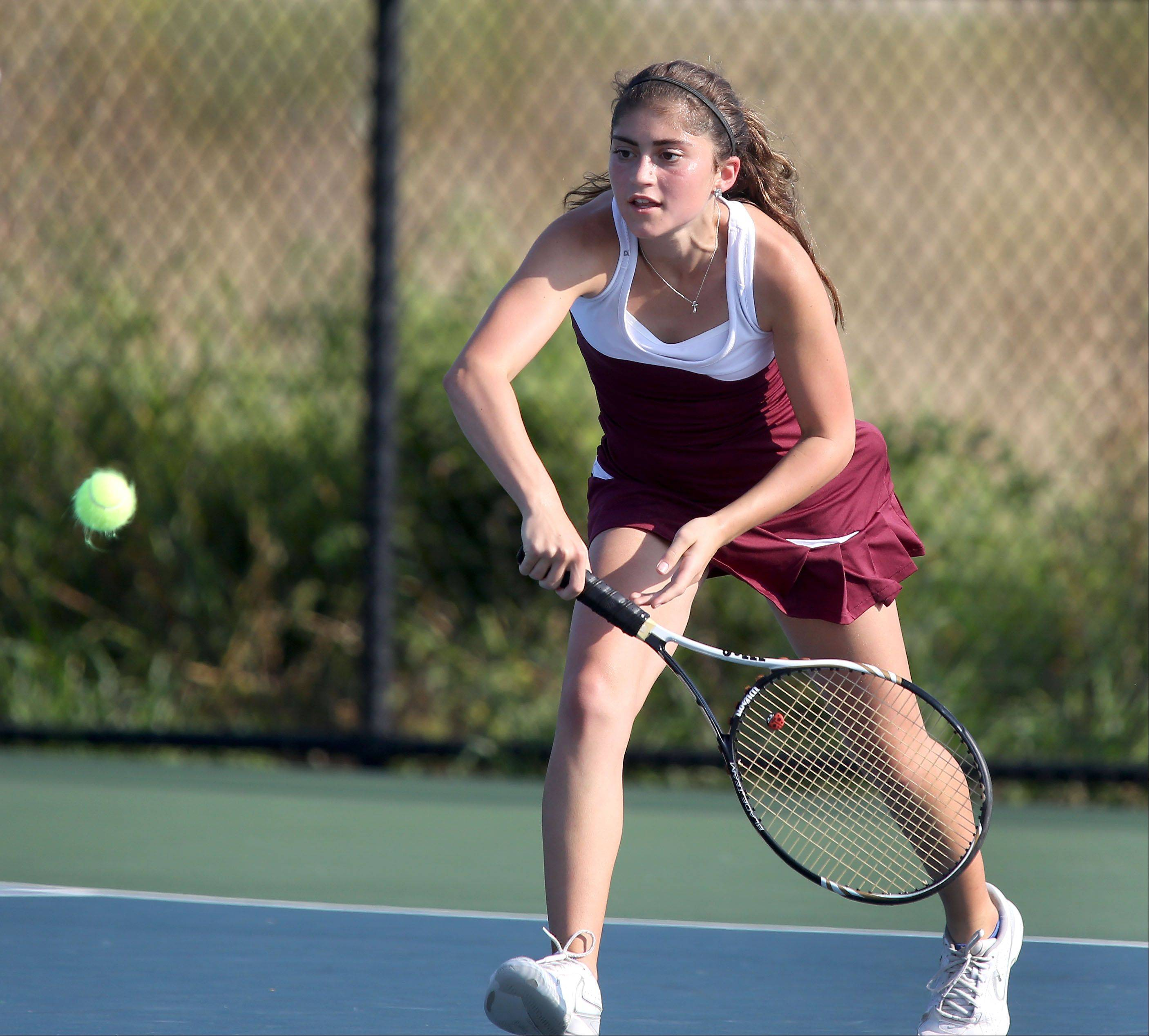 Gabby Stinsa of Montini moves in for a return against Lisle during girls tennis on Monday in Lisle.