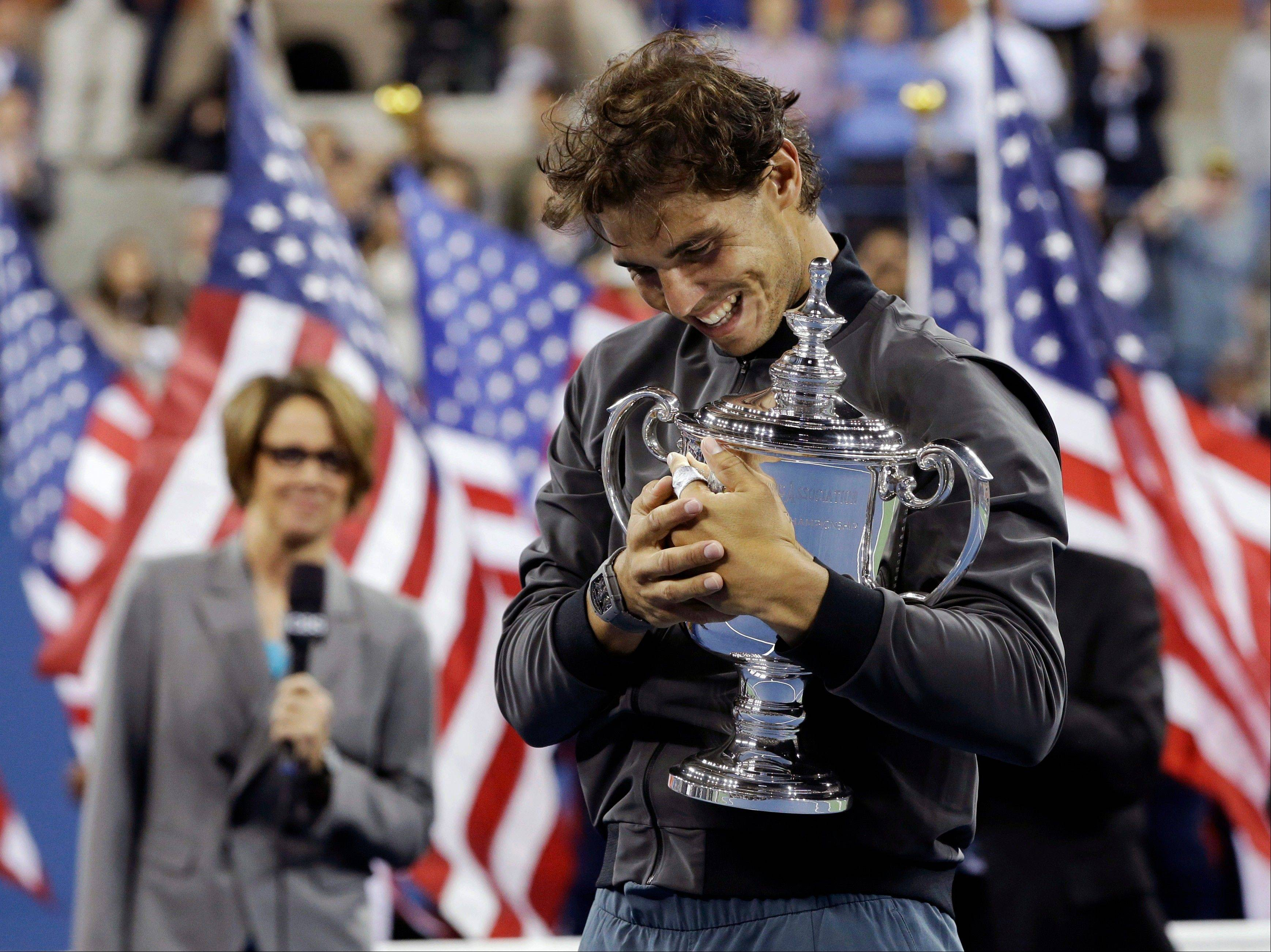 Rafael Nadal hugs the championship trophy after winning the men's singles final over Novak Djokovic on Monday night at the U.S. Open in New York.