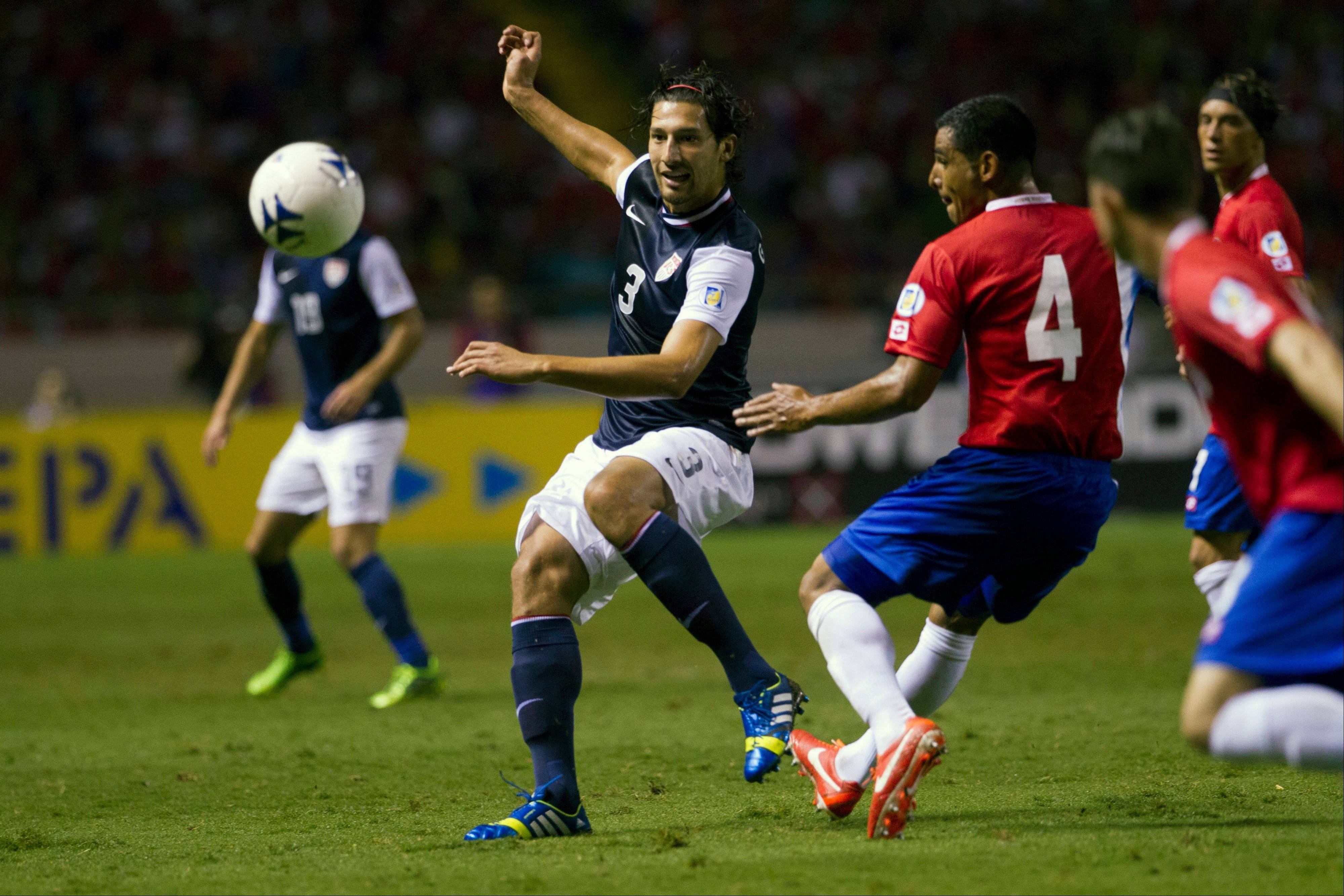 The United States' Omar Gonzalez, left, and Costa Rica's Michael Umana fight for the ball during a World Cup qualifier Friday in San Jose, Costa Rica. The U.S. lost 3-1.