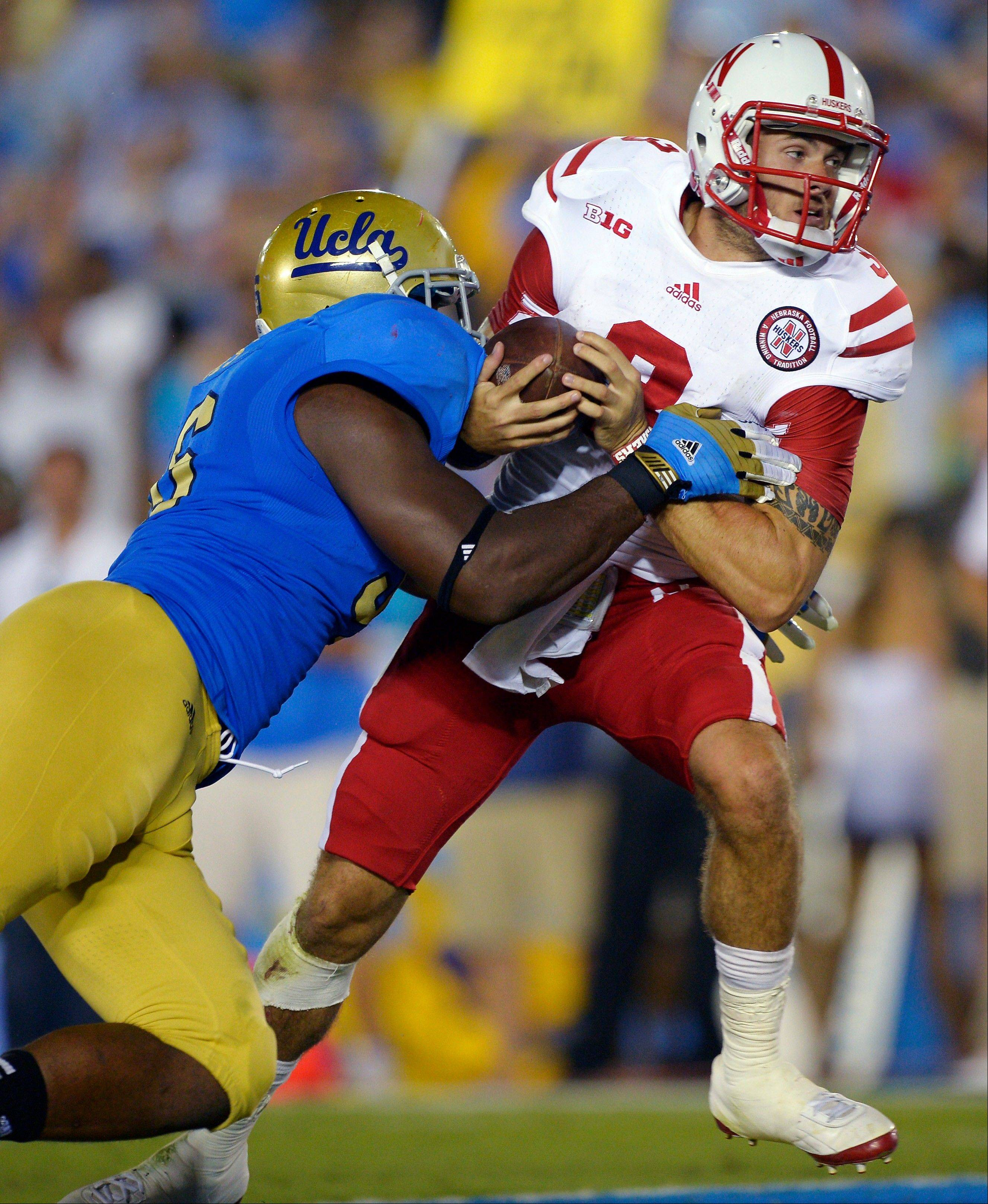 UCLA defensive end Datone Jones sacks Nebraska quarterback Taylor Martinez for a safety during last season's game in Pasadena, Calif.